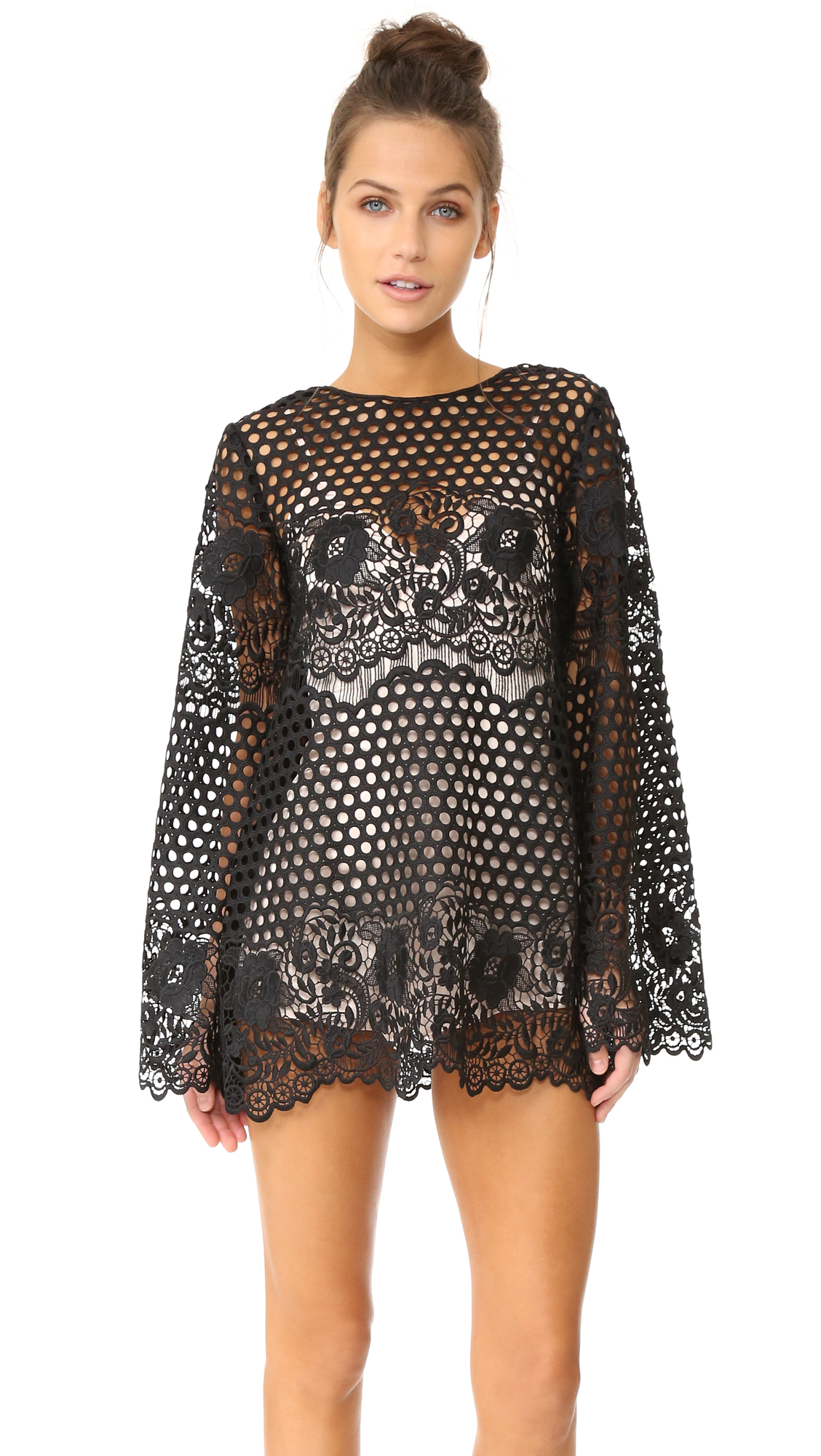 Description NOTE: Sizes listed are Australian. Please see Size & Fit tab. A striking Alice McCall shift dress in mixed guipure lace. Flared long sleeves. Hidden back zip. Optional slip lining. Fabric: Lace. Shell: 100% polyester. Trim: 100% nylon.