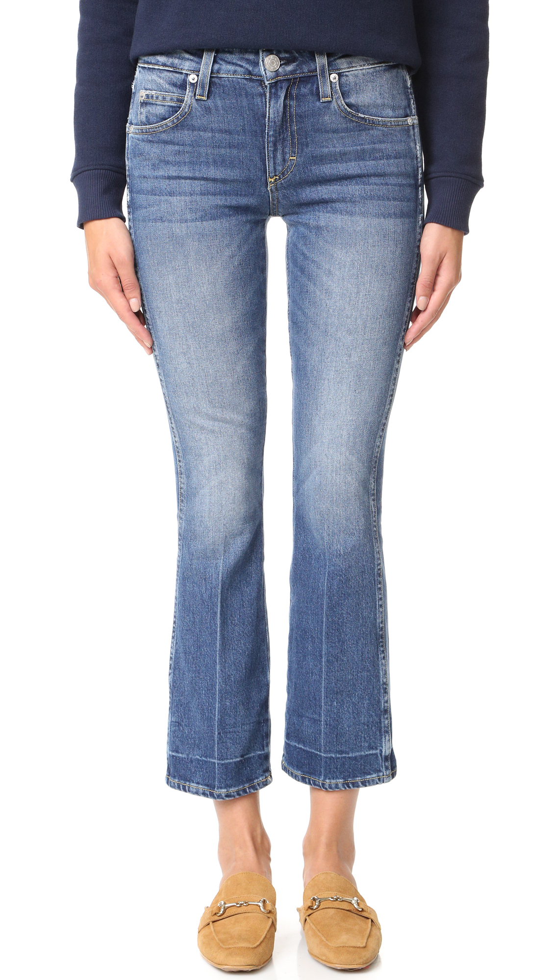Fading and whiskering lend a time worn effect to these ankle length AMO flares. 5 pocket styling. Button closure and zip fly. Fabric: Stretch denim. 98% cotton/2% elastane. Wash cold. Made in the USA. Imported materials. Measurements Rise: 9.5