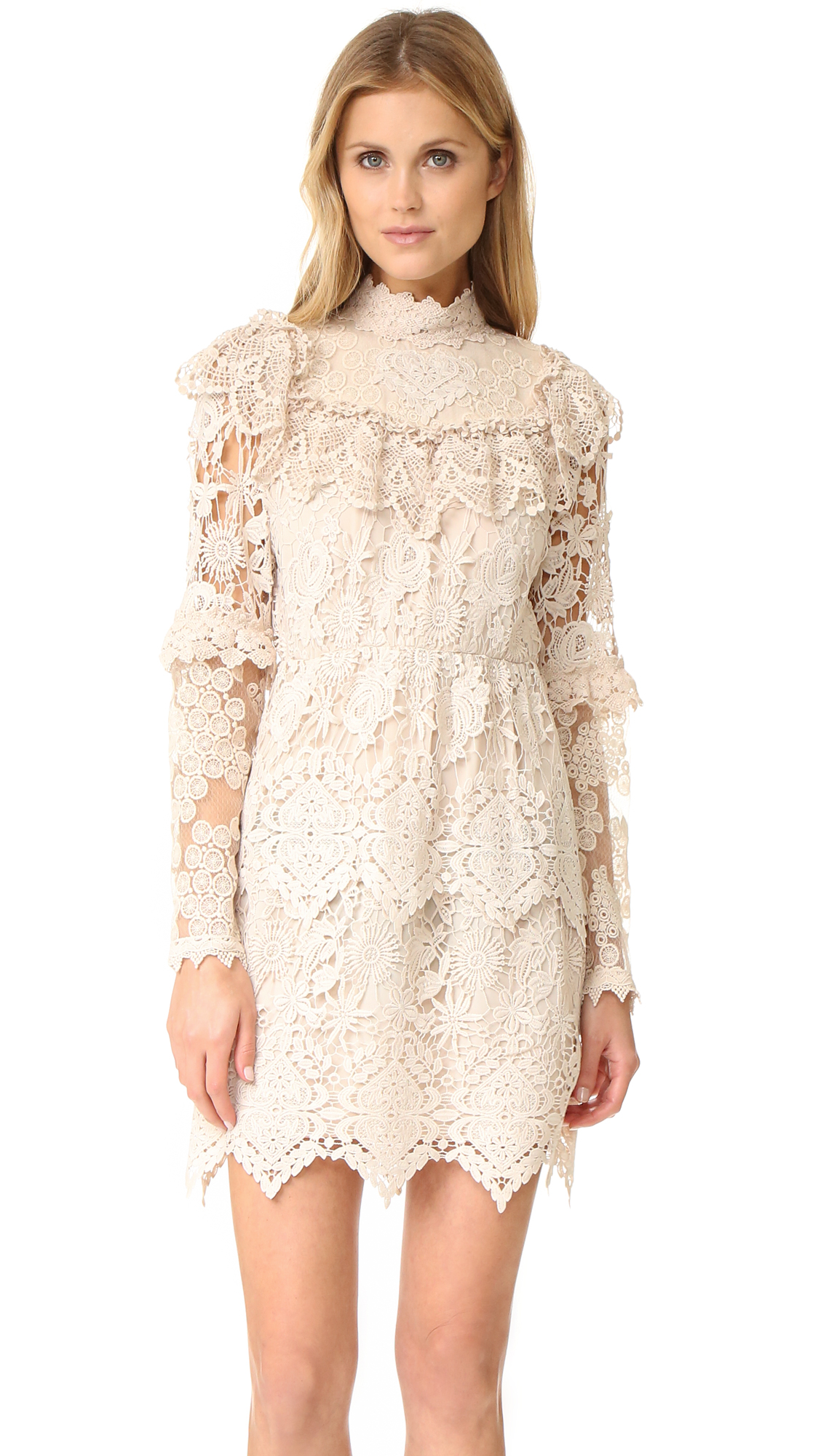 A romantic, victorian inspired Anna Sui dress made from delicate lace. The sheer yoke and sleeves are detailed with filmy, embroidered insets. Ruffle trim and zigzag edges add a dainty finish. Hidden back zip. Tonal lining.