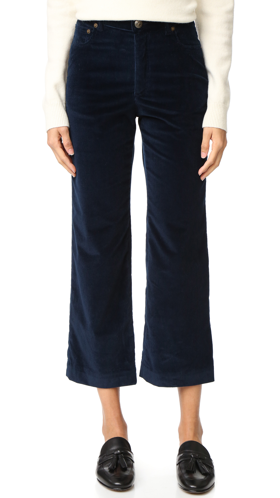 High waisted, wide leg A.P.C. pants cut from wide wale corduroy. 5 pocket styling. Button closure and zip fly. Fabric: Stretch corduroy. 98% cotton/2% elastane. Dry clean. Made in Portugal. Measurements Rise: 9.75in / 25cm Inseam: 26.75in / 68