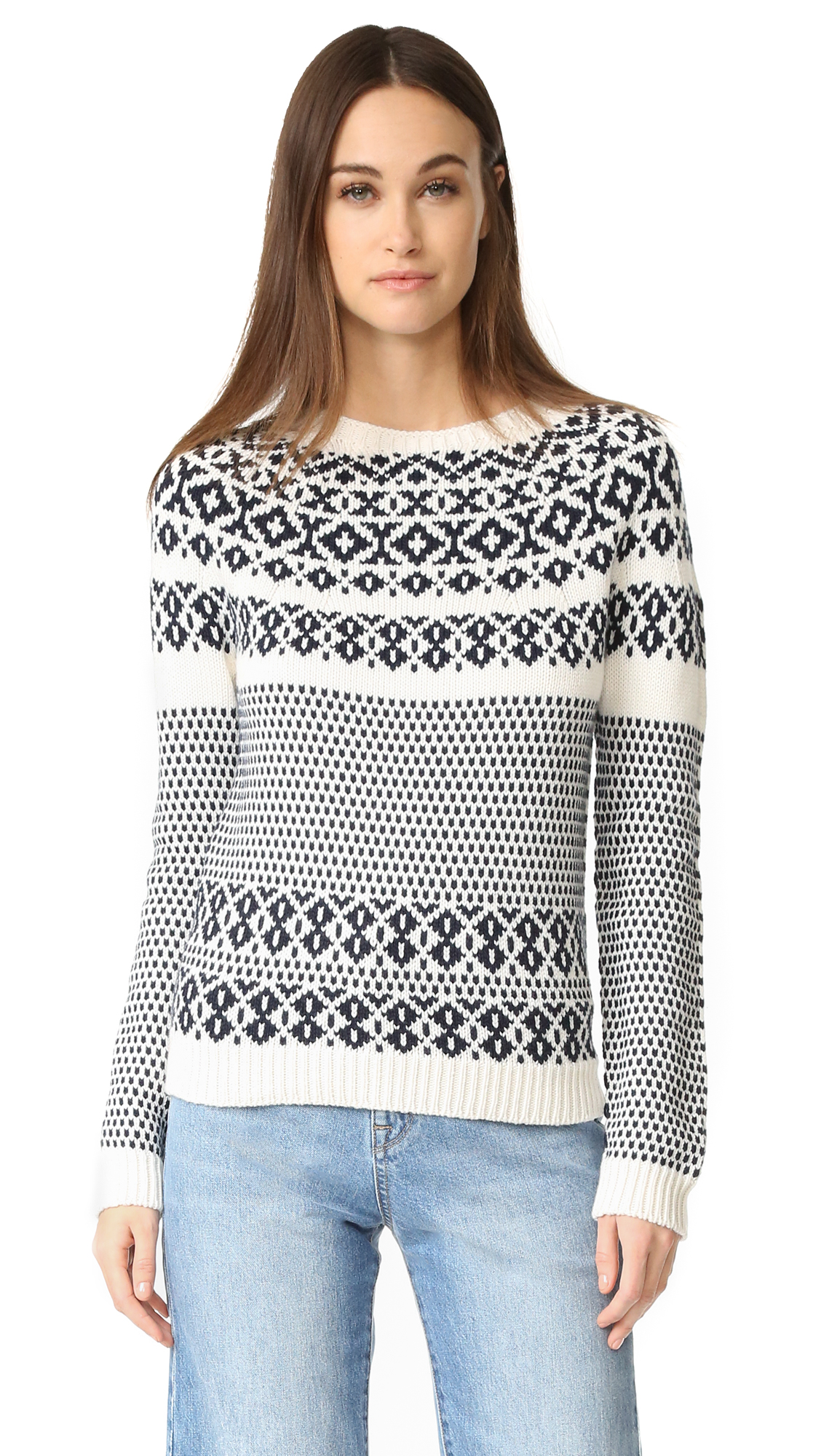 A two tone A.P.C. fair isle sweater, constructed with dolman sleeves for a relaxed fit. Ribbed edges. Fabric: Fair isle knit. 52% merino wool/48% cotton. Hand wash or dry clean. Made in Italy. Measurements Length: 24.5