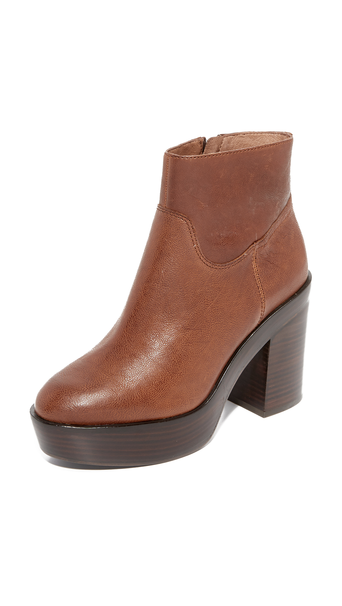 A stacked platform adds a substantial lift to these pebbled leather Ash booties. Exposed side zip. Chunky heel and leather sole. Leather: Calfskin. Imported, China. This item cannot be gift boxed. Measurements Heel: 3.75in / 95mm Platform: 1.5
