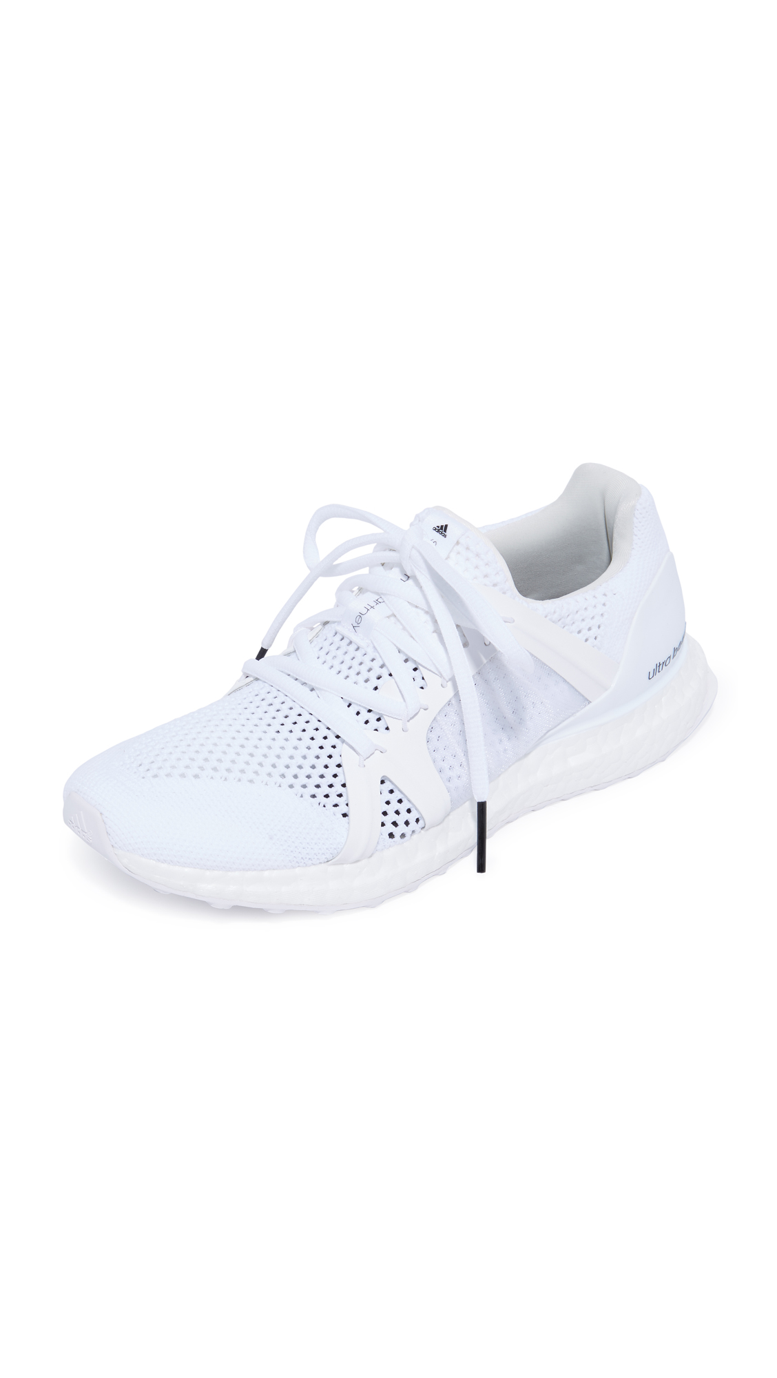 Sporty adidas by Stella McCartney sneakers in a mix of tonal knits. Laces secure the rubber and mesh side panels. A padded collar and footbed add comfort. Textured foam sidewall. Rubber sole. Fabric: Mixed knit. Imported,