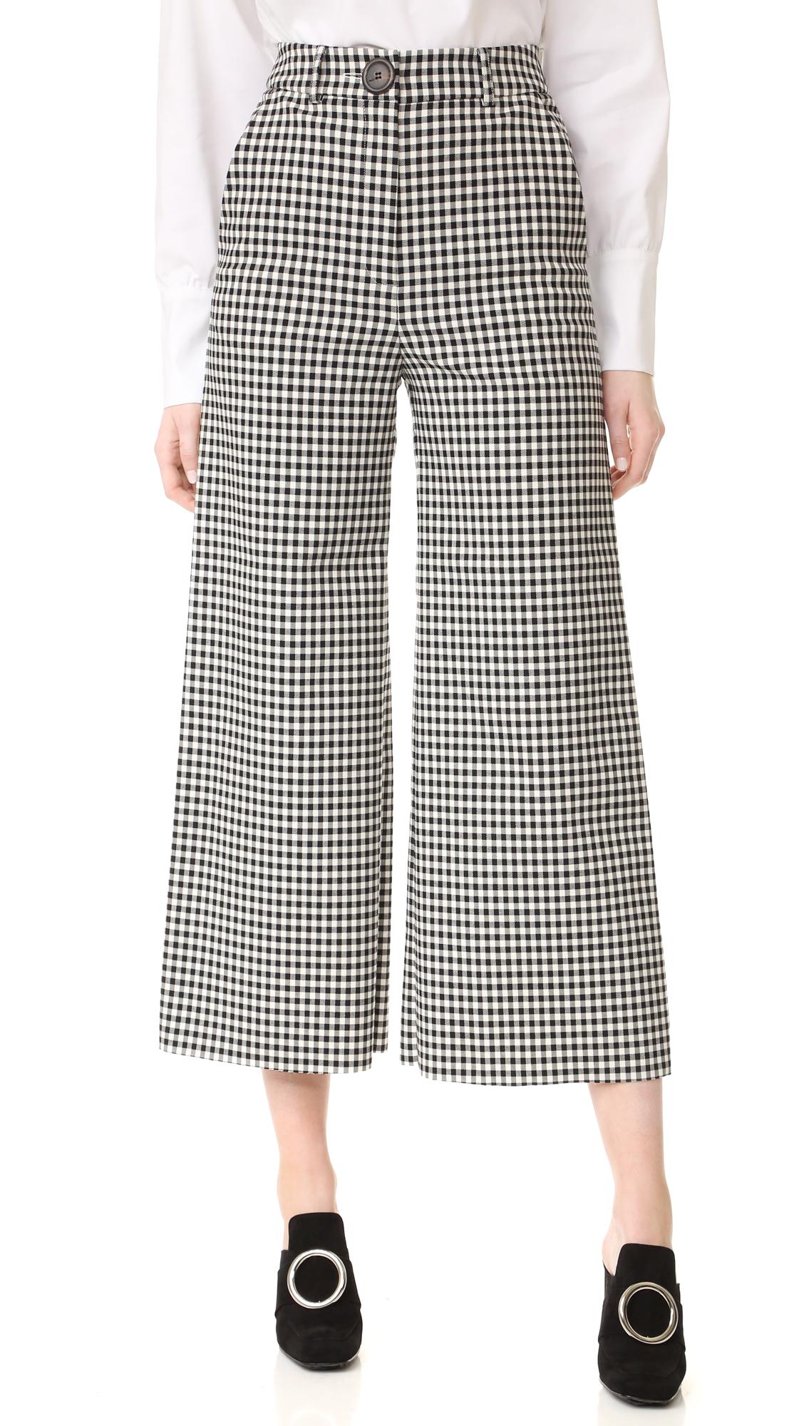 Bold gingham checks accent these high waisted A.W.A.K.E. culottes. Slant front pockets. Natural horn button closure and zip fly. Fabric: Fused suiting. 32% cotton/31% polyester/16% viscose/12% wool/6% polyurethane. Dry clean. Made in United