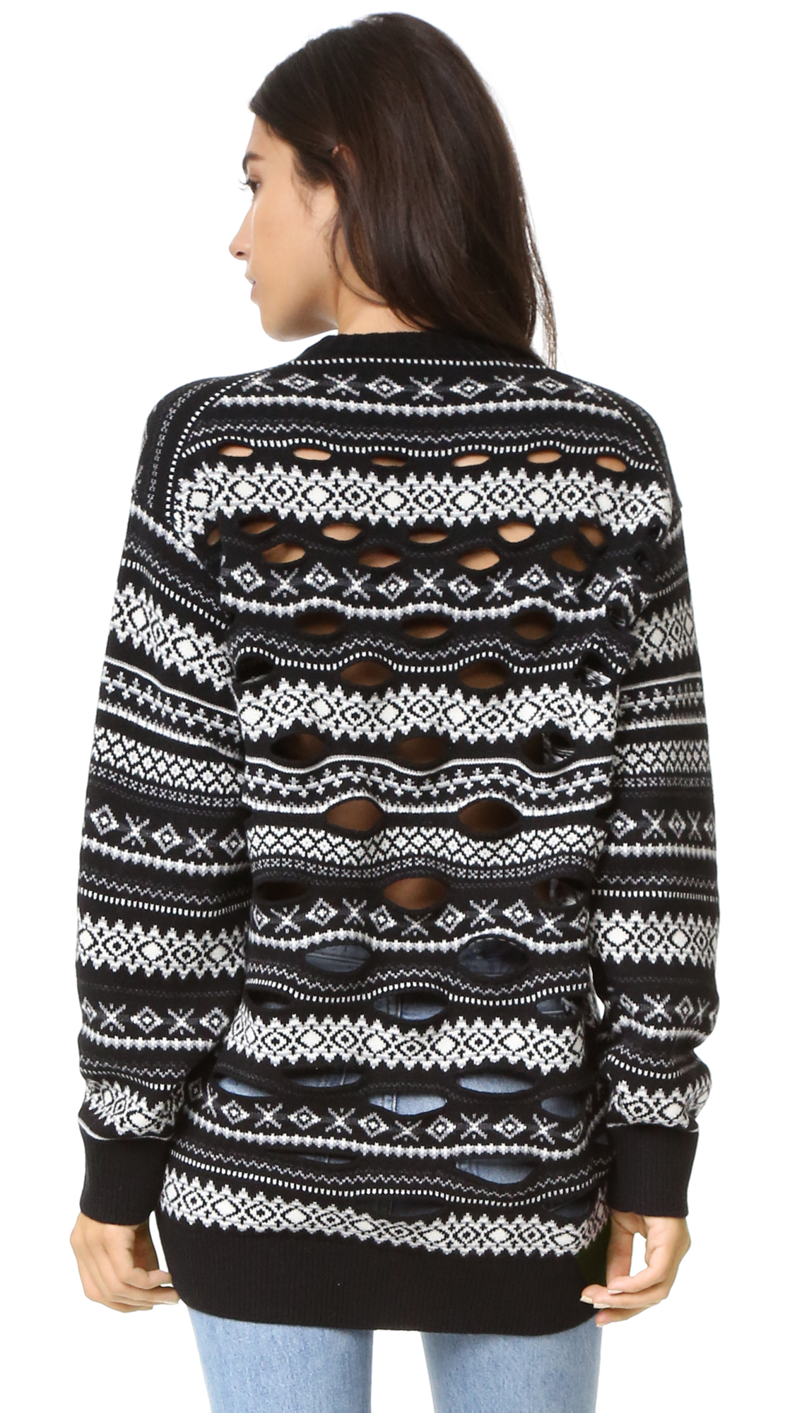 This fair isle knit Alexander Wang sweater has slits in back, giving the classic crew neck silhouette a unique, undone finish. Oversized profile. Ribbed edges and long sleeves. Semi sheer. Fabric: Fair isle knit. 50% wool/30% viscose/20%