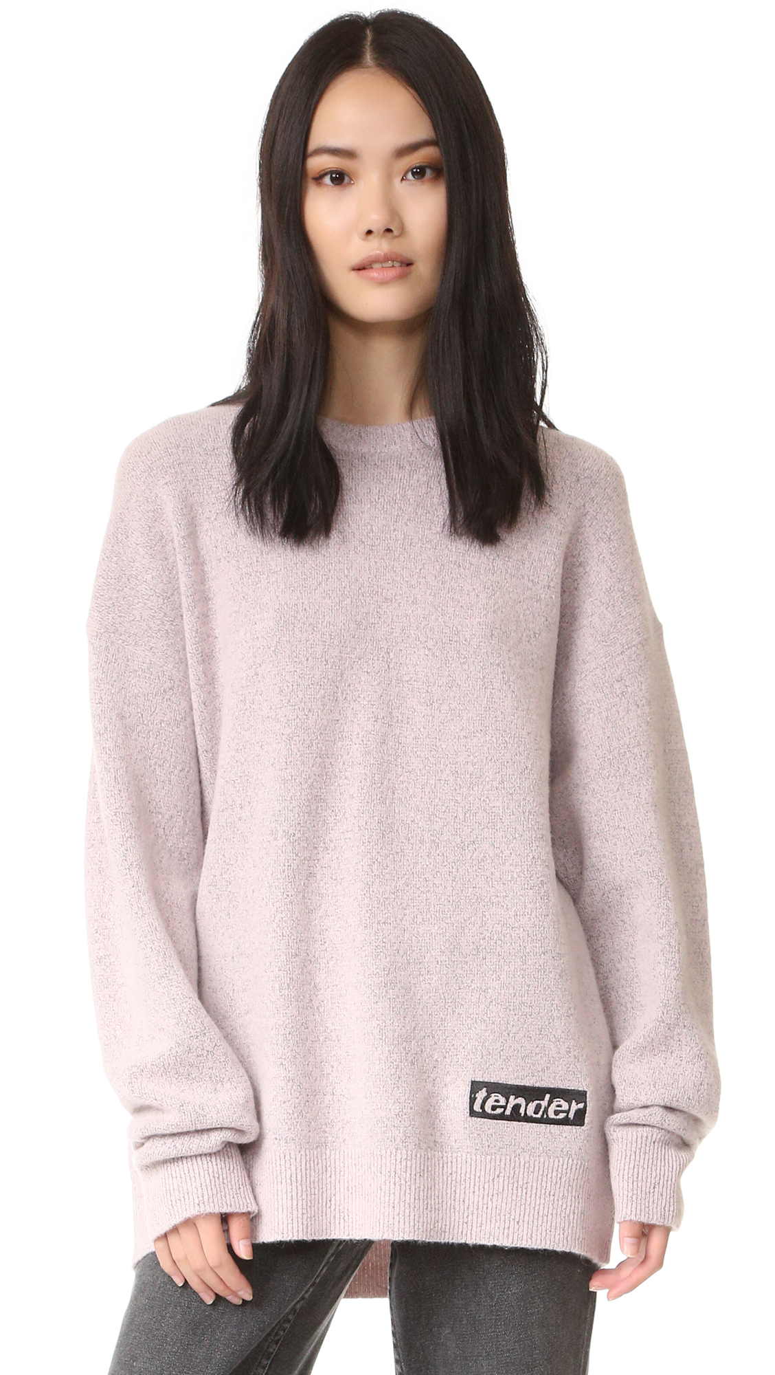 This boxy Alexander Wang sweater is detailed with 'tender' lettering at the embroidered patch. Crew neckline. Ribbed edges and long sleeves. Fabric: Fuzzy knit. Shell: 41% wool/32% nylon/25% alpaca/2% spandex. Trim: 38% nylon/37% wool/22% alpaca/3% spandex. Dry clean.