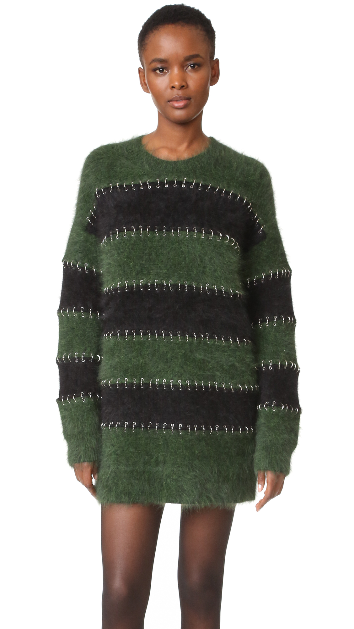 Silver tone hoops pierce the pieced stripes on this sleek, fuzzy Alexander Wang sweater dress. High neckline. Long sleeves. Unlined. Fabric: Brushed knit. 54% wool/36% angora fur fiber/10% nylon. Dry clean. Imported, China. Measurements Length: 29.25in / 74cm,