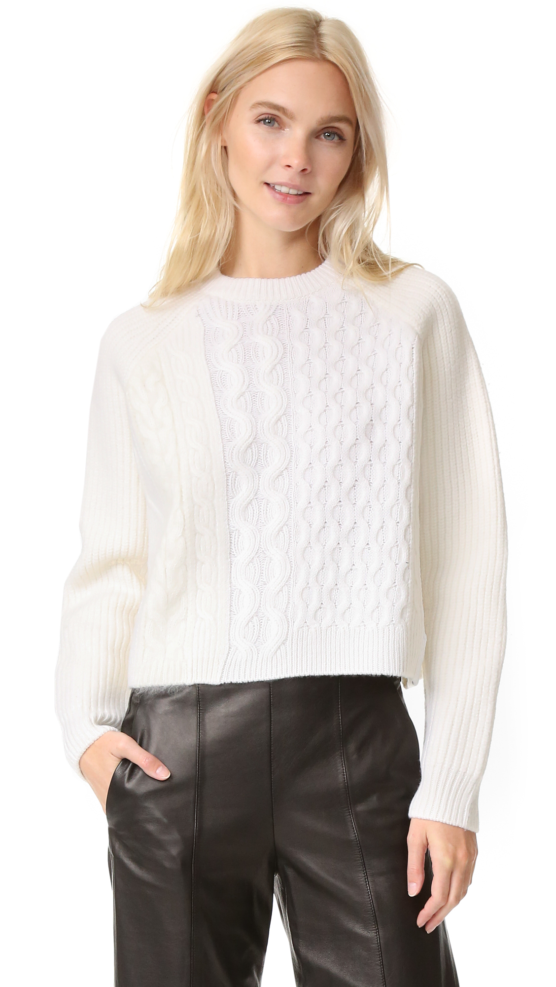 A combination of cable knit patterns come together on this cropped Alexander Wang sweater. Ribbed crew neck and long raglan sleeves. Fabric: Cable knit. 64% wool/11% viscose/10% cashmere/7% cotton/6% angora fur fiber/2% polyamide. Dry clean. Imported, China.