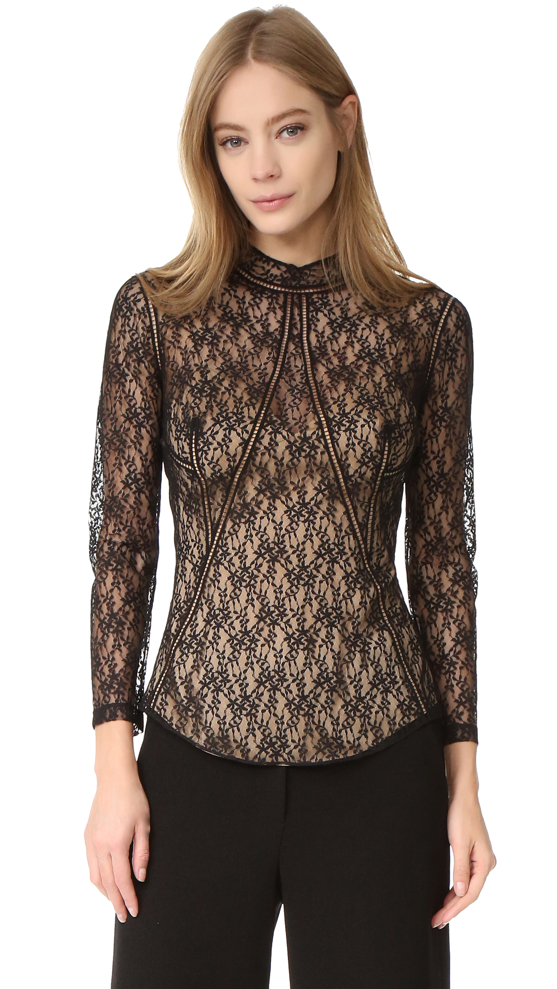 A formfitting lace Alexander Wang blouse in a tiny leaf pattern. Embroidered ladder seaming. Sheer long sleeves. Exposed back zip. Optional tank lining. Fabric: Lace. Shell: 100% nylon. Lining: 92% silk/8% lycra spandex. Dry clean. Imported, China. Measurements