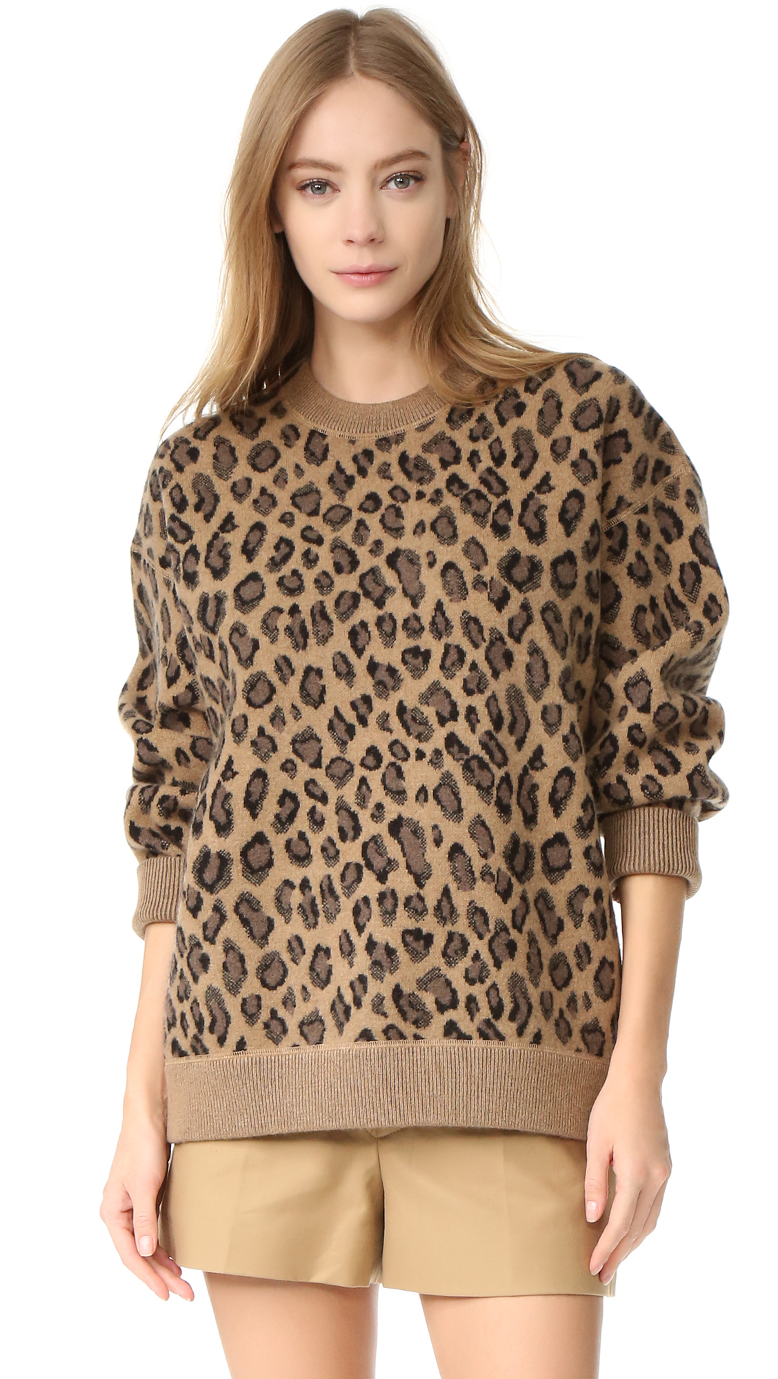 Leopard spots accent this boxy Alexander Wang sweater, rendered in a soft wool cashmere blend. Crew neckline. Ribbed edges and long sleeves. Fabric: Thick double knit. 90% wool/10% cashmere. Dry clean. Imported, China. Measurements Length: 26.75in / 68cm,