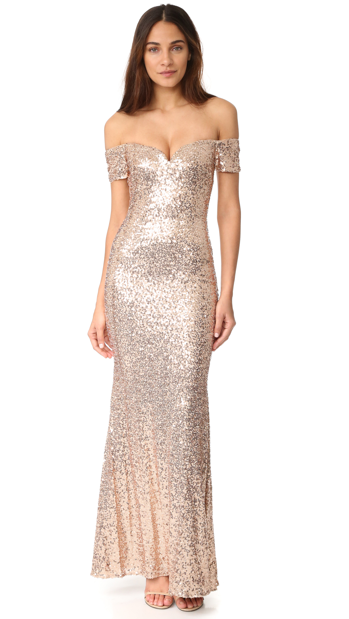 Spangled sequins lend timeless glamour to this off shoulder Badgley Mischka Collection gown. Inset wiring shapes the sweetheart neckline. Nonslip rubber binding at top hem. Flexible boning. Hidden back zip. Lined. Fabric: Embroidered mesh. Shell: 100% nylon.
