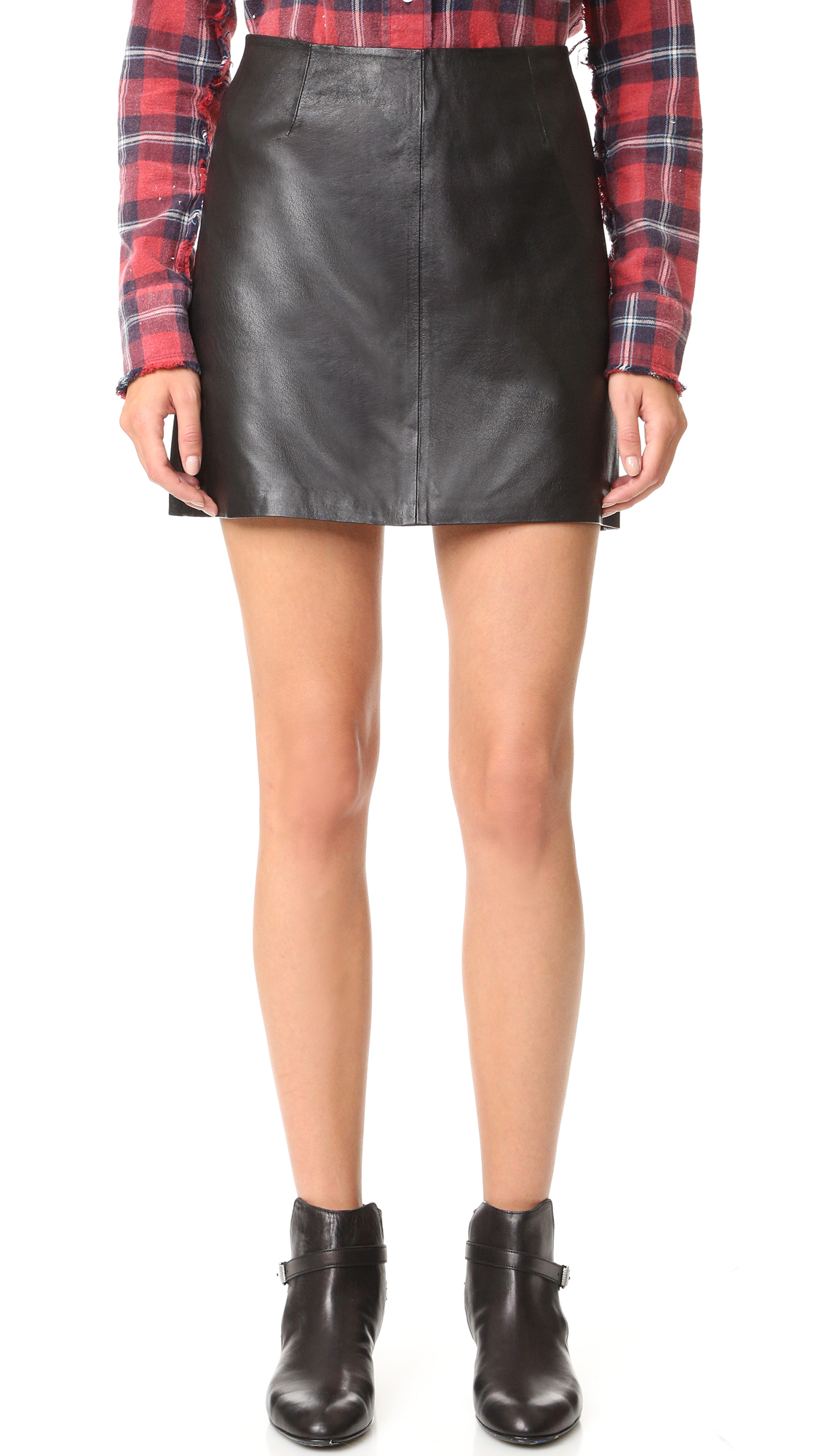 A leather BB Dakota miniskirt in a classic A line profile. Hidden back zip. Lined. Fabric: Soft leather. Shell: 100% pigskin. Lining: 100% polyester. Leather clean. Imported, China. Measurements Length: 15.25in / 39cm Measurements from size 4. Available sizes: 4,6,10