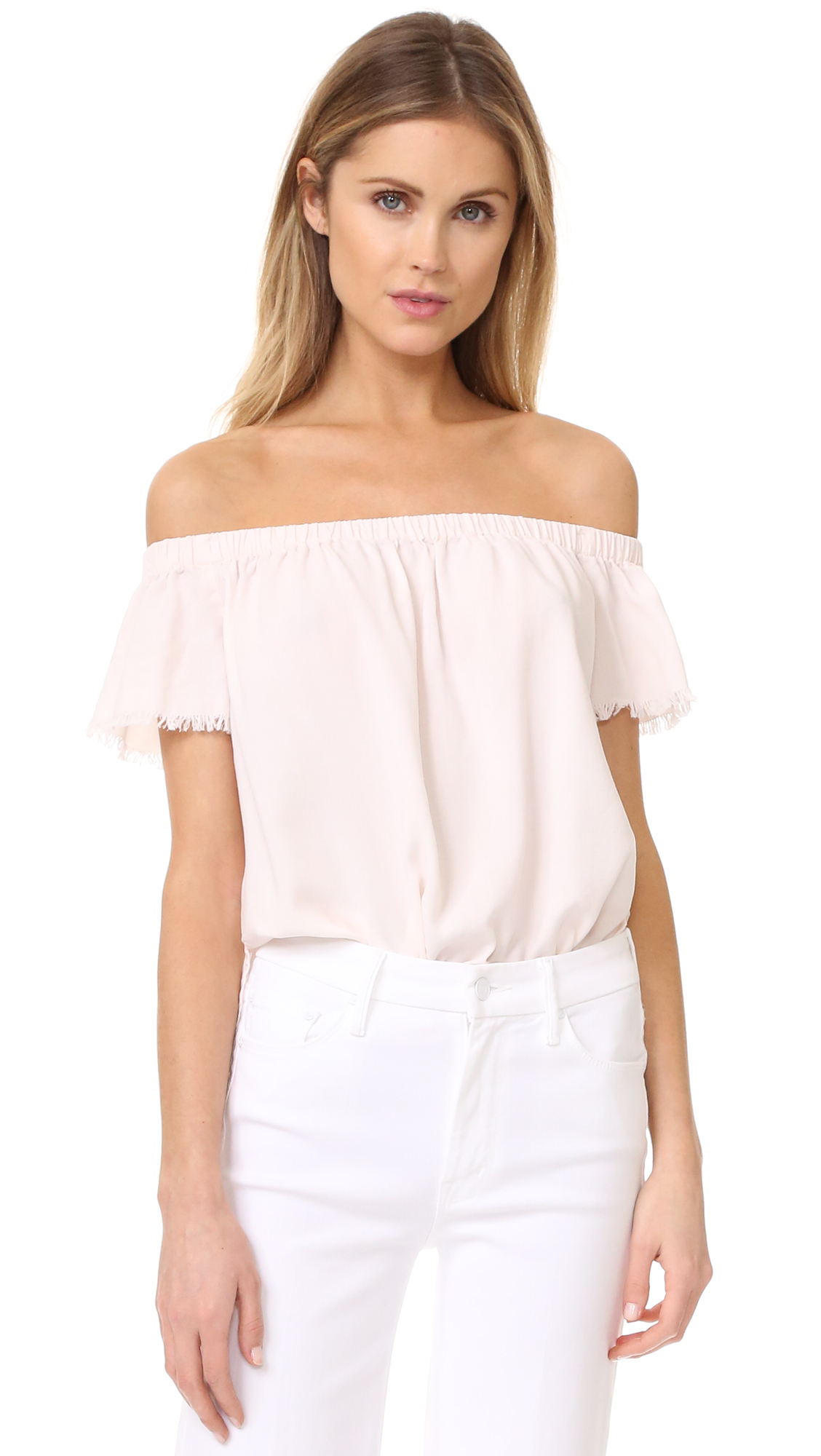 A relaxed Bella Dahl off shoulder top with a frayed hem and cuffs. Gathered elastic neckline. Short sleeves. Fabric: Voile. 100% lyocell. Wash cold. Imported, China. Measurements Length: 18.5in / 47cm, from center back Measurements from size S.