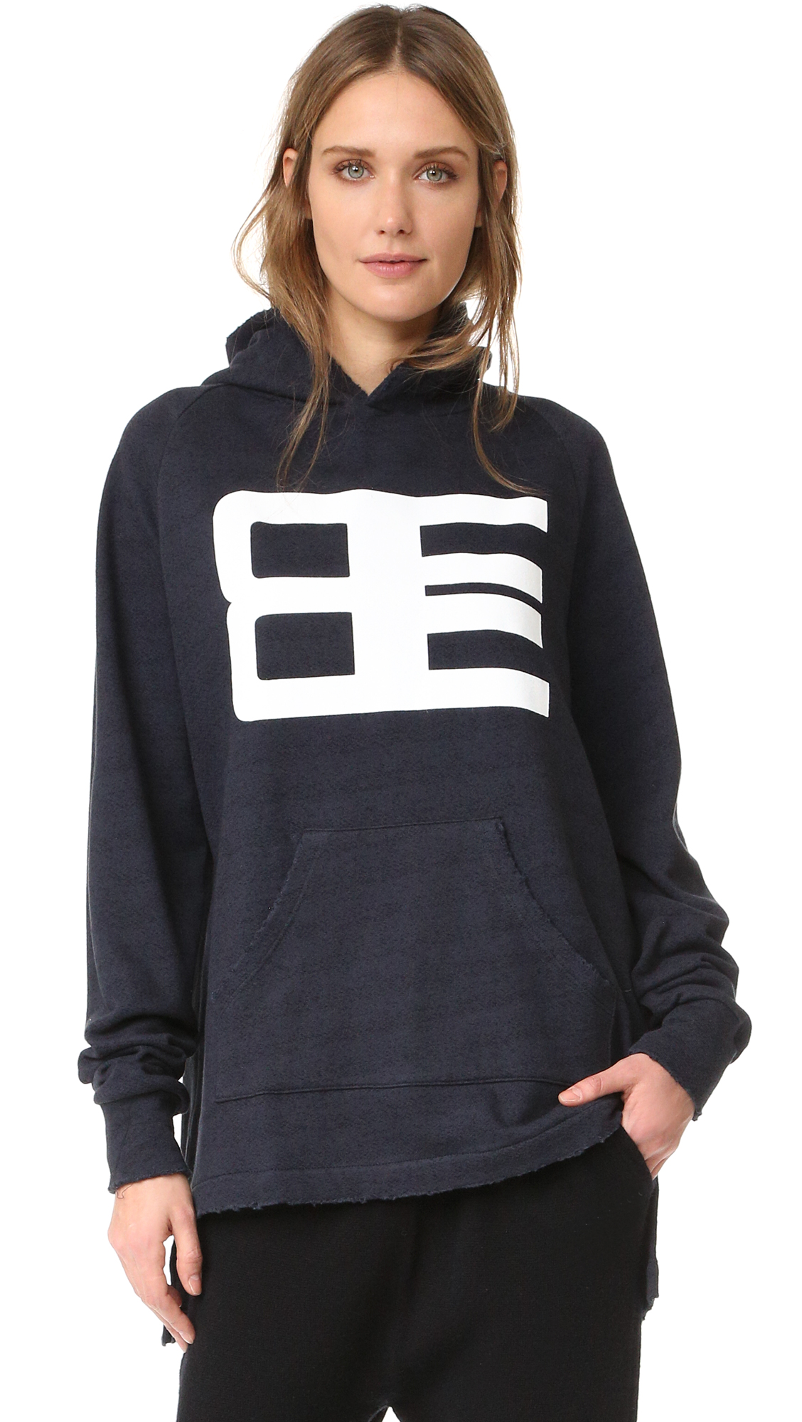 A bold logo graphic accents this Baja East hoodie. Worn edges and a split, uneven hem create a relaxed look. Pouch pocket. Long sleeves. Fabric: French terry. 100% cotton. Wash cold. Made in the USA. Measurements Length 1: 26