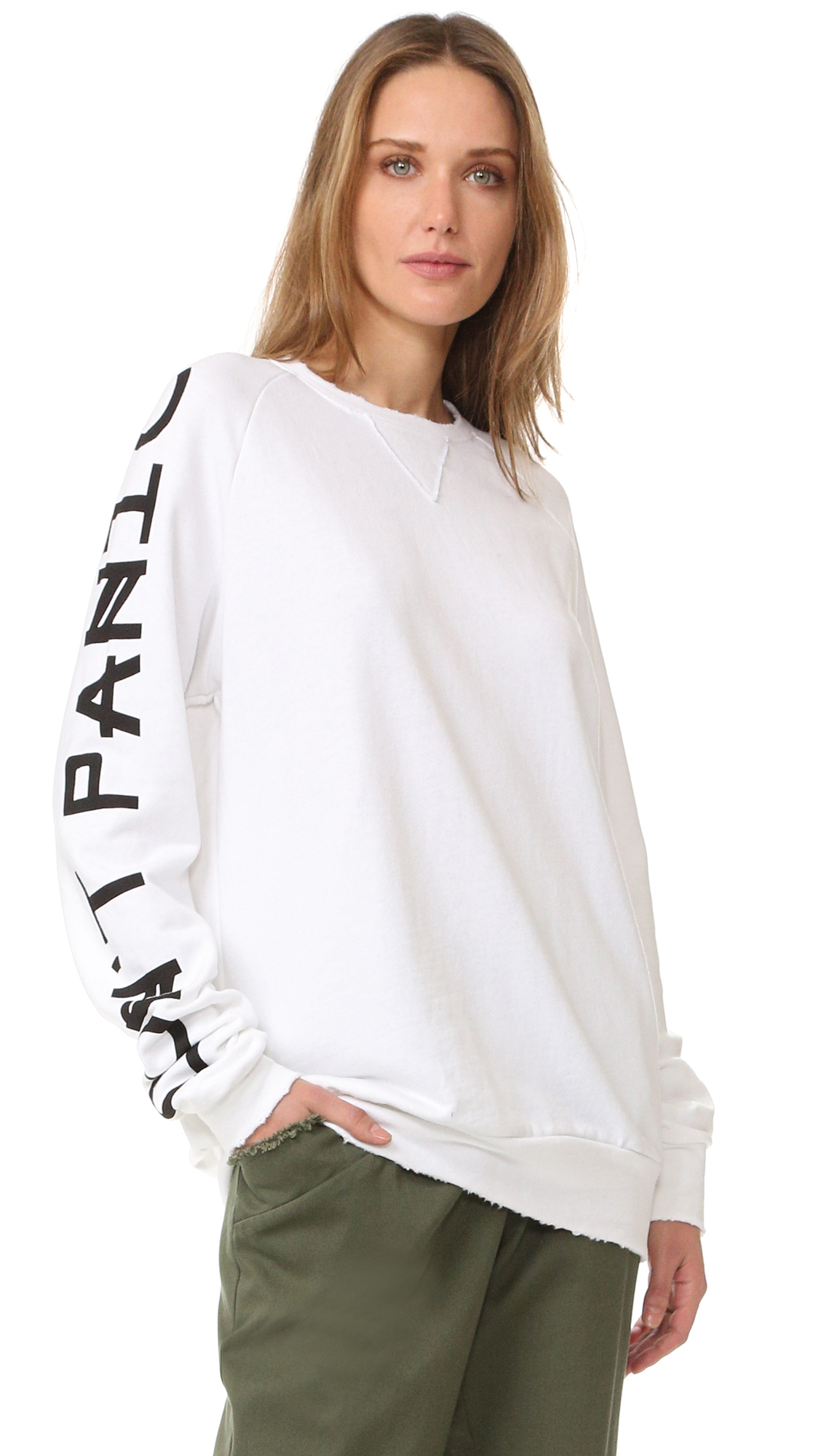 Bold 'Don't Panic' lettering accents this Baja East sweatshirt. Worn edges create an undone finish. Crew neckline with triangle inset. Long sleeves. Fabric: French terry. 100% supima cotton. Wash cold. Made in the USA. Measurements Length: 25.5in / 65