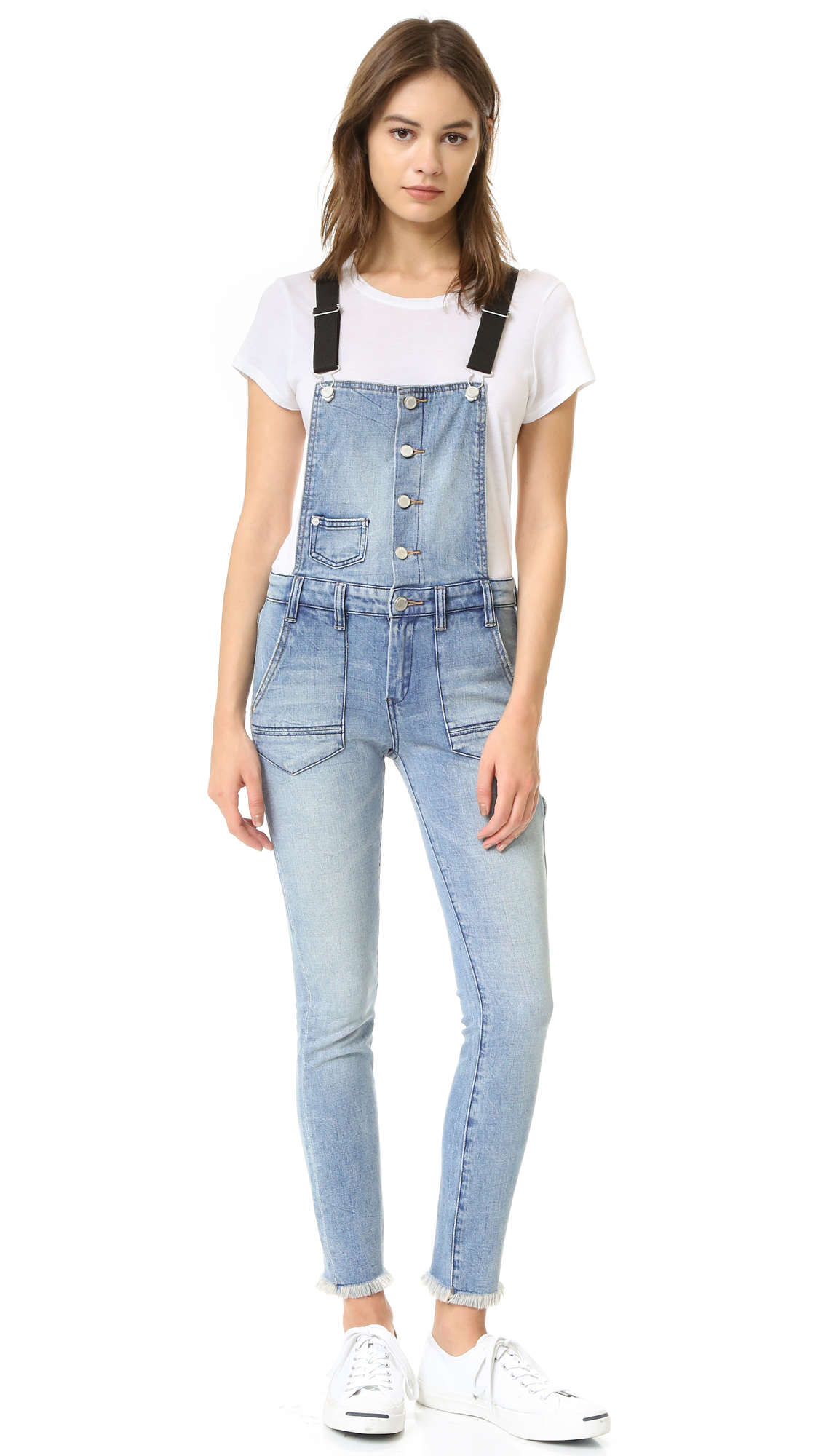 Suspender style buckle straps add a unique touch to these button up Blank Denim overalls. 4 pocket styling with hammer pouch. Zip fly. Raw hem. Fabric: Stretch denim. 98% cotton/2% elastane. Wash cold. Imported, China. Measurements Rise: 9.5in / 24