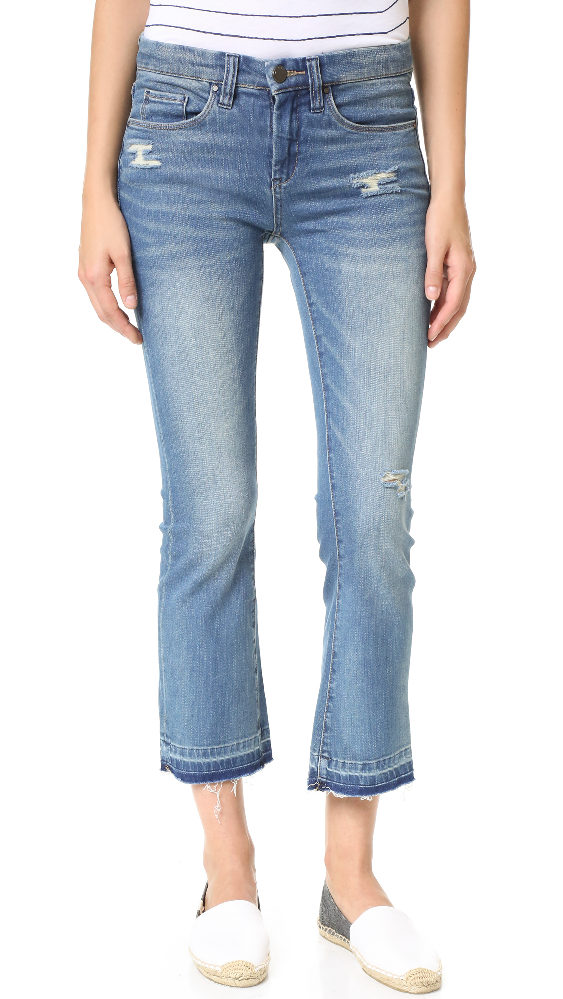 Shredded spots and a frayed, overdyed hem give these Blank Denim jeans a deconstructed look. Worn edges. 5 pocket styling. Button closure and zip fly. Fabric: Lightweight stretch denim. 97% cotton/3% spandex. Wash cold. Imported, China. Measurements Rise: 9