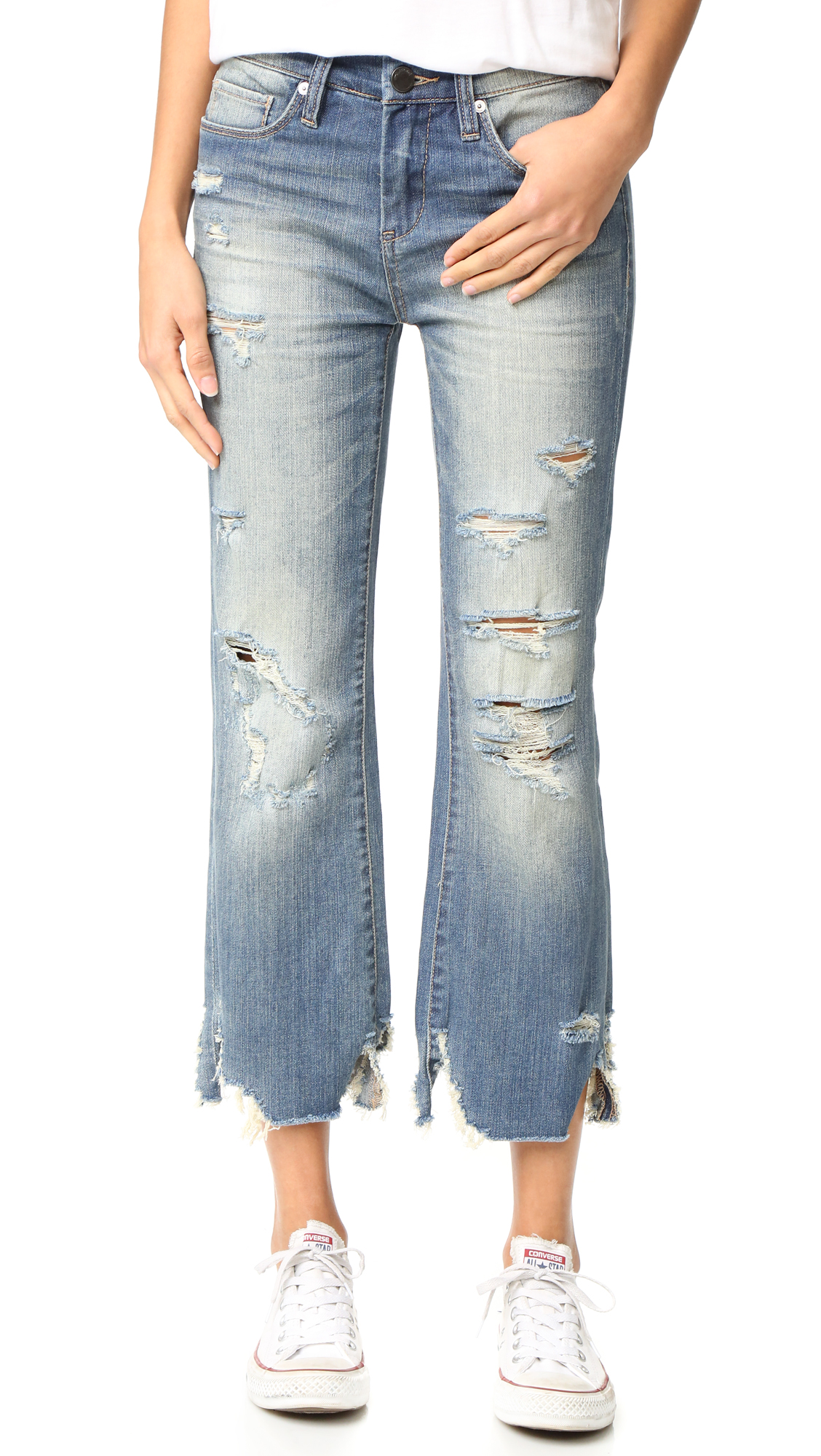 Intense fading and shredded holes effect a look of hard wear on these relaxed Blank Denim jeans. 5 pocket styling. Button closure and zip fly. Fabric: Lightweight stretch denim. 99% cotton/1% lycra spandex. Wash cold. Imported, China. Measurements
