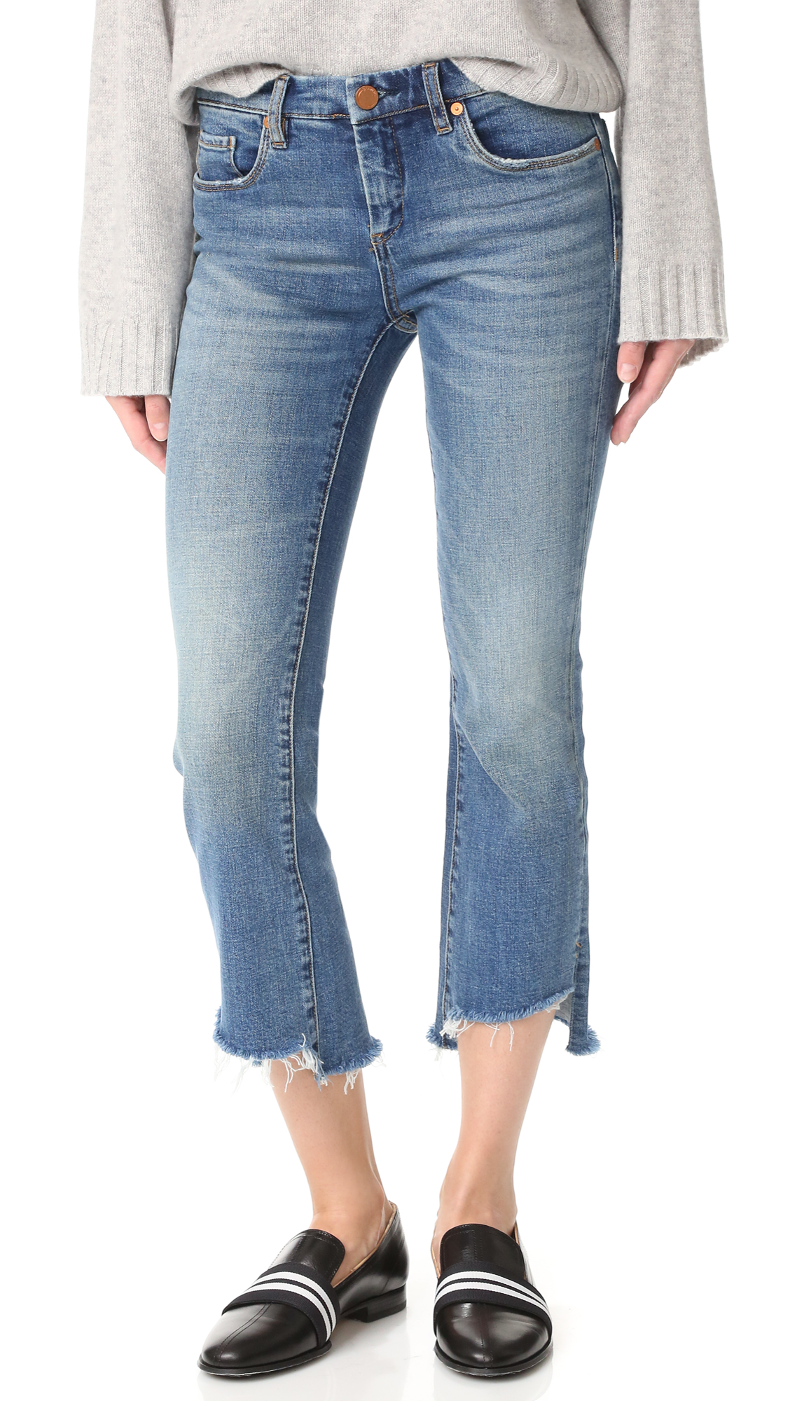 Allover fading and a frayed step hem give these flared Blank Denim jeans a deconstructed look. Worn edges. 5 pocket styling. Button closure and zip fly. Fabric: Stretch denim. 99% cotton/1% spandex. Wash cold. Imported, China. Measurements Rise: 9