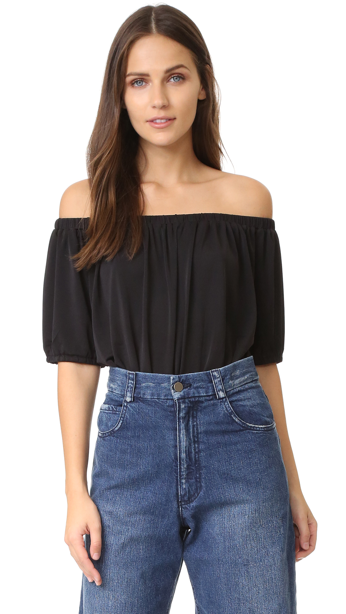 A blouson bodice and off shoulder neckline give this Blaque Label bodysuit a feminine profile. Draped panels form a cutout in back. Short sleeves. Snap closures at inseam. Fabric: Slinky jersey. 90% polyester/10% spandex. Dry clean. Imported,