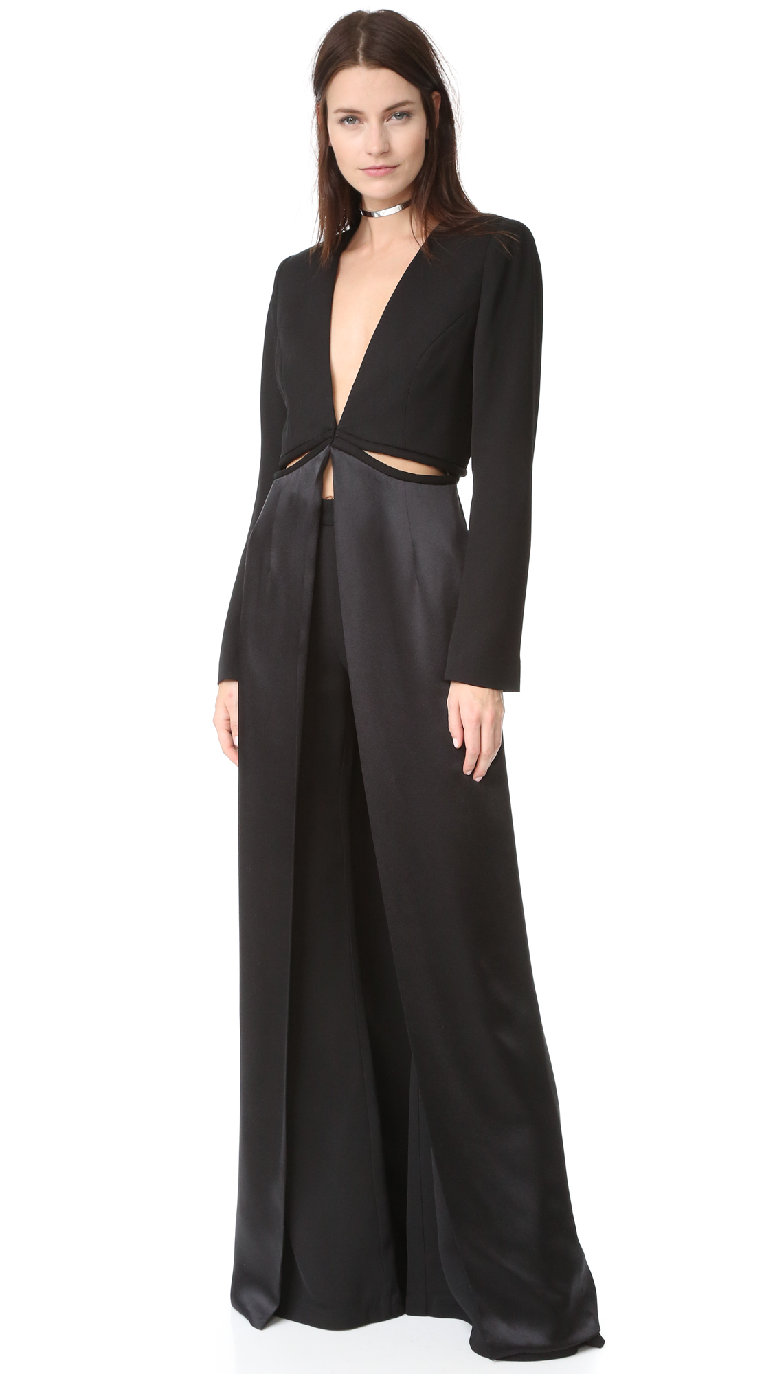 A unique Brandon Maxwell coat in a dramatic, fluid shape. Interior buttons join the substantial bodice and lustrous skirt, and cutouts add a flirty finish. Padding structures the shoulders. Hook and eye closures. Long sleeves. Lined.