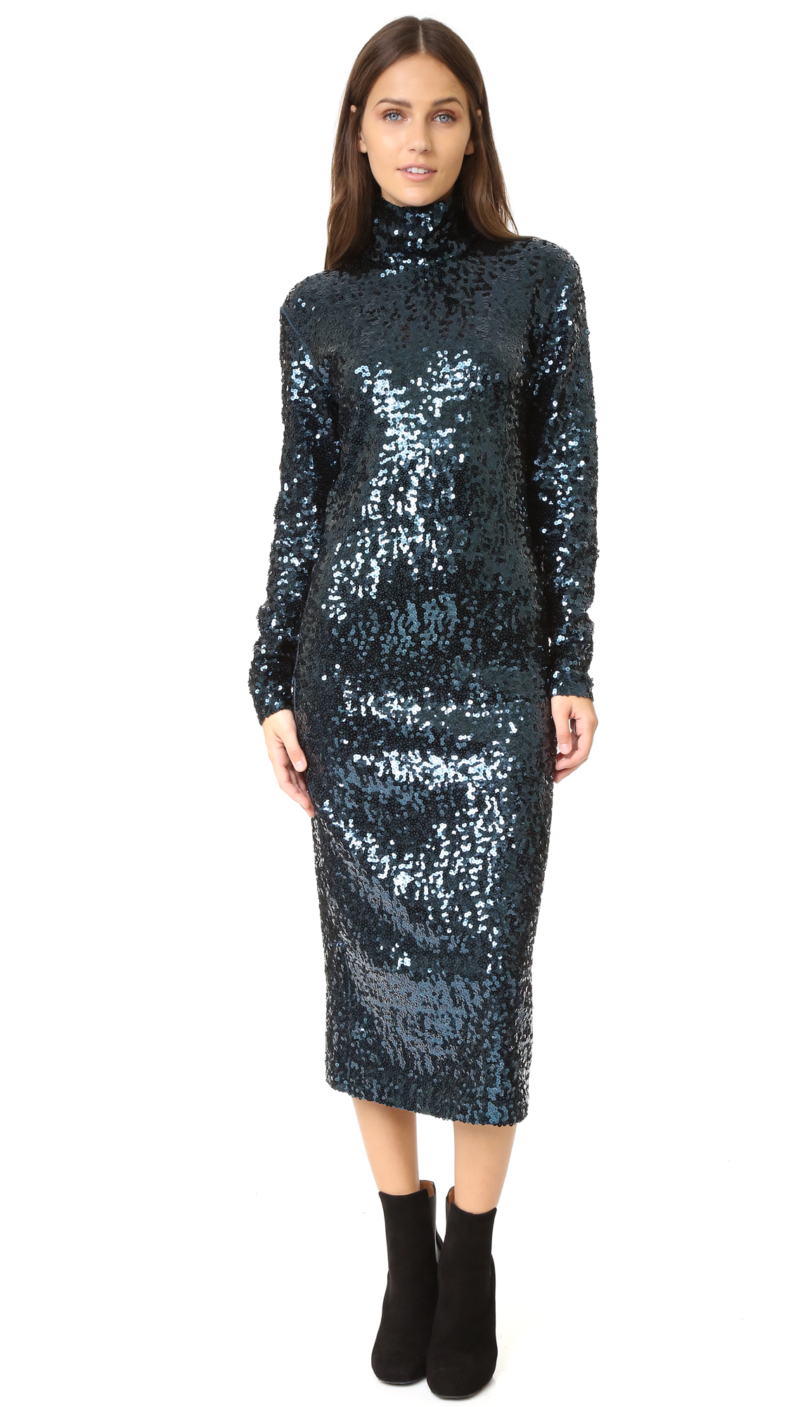 A formfitting By Malene Birger turtleneck dress, covered with eye catching sequins. Long sleeves. Hidden back zip. Lined. Fabric: Sequined jersey. Shell: 95% cotton/5% elastane. Trim: 100% polyester. Lining: 100% viscose. Hand wash. Imported, China. Measurements Length: 46.5in / 118cm,