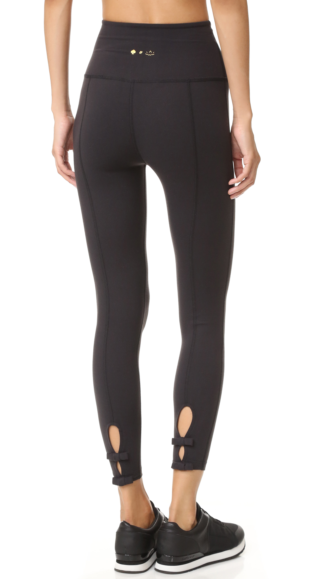 Beyond Yoga x Kate Spade New York high rise leggings, detailed with bows at the cutout cuffs. Flat overlock seams lend a close, comfortable fit. Fabric: Activewear jersey. 90% supplex nylon/10% lycra spandex. Wash cold. Made in