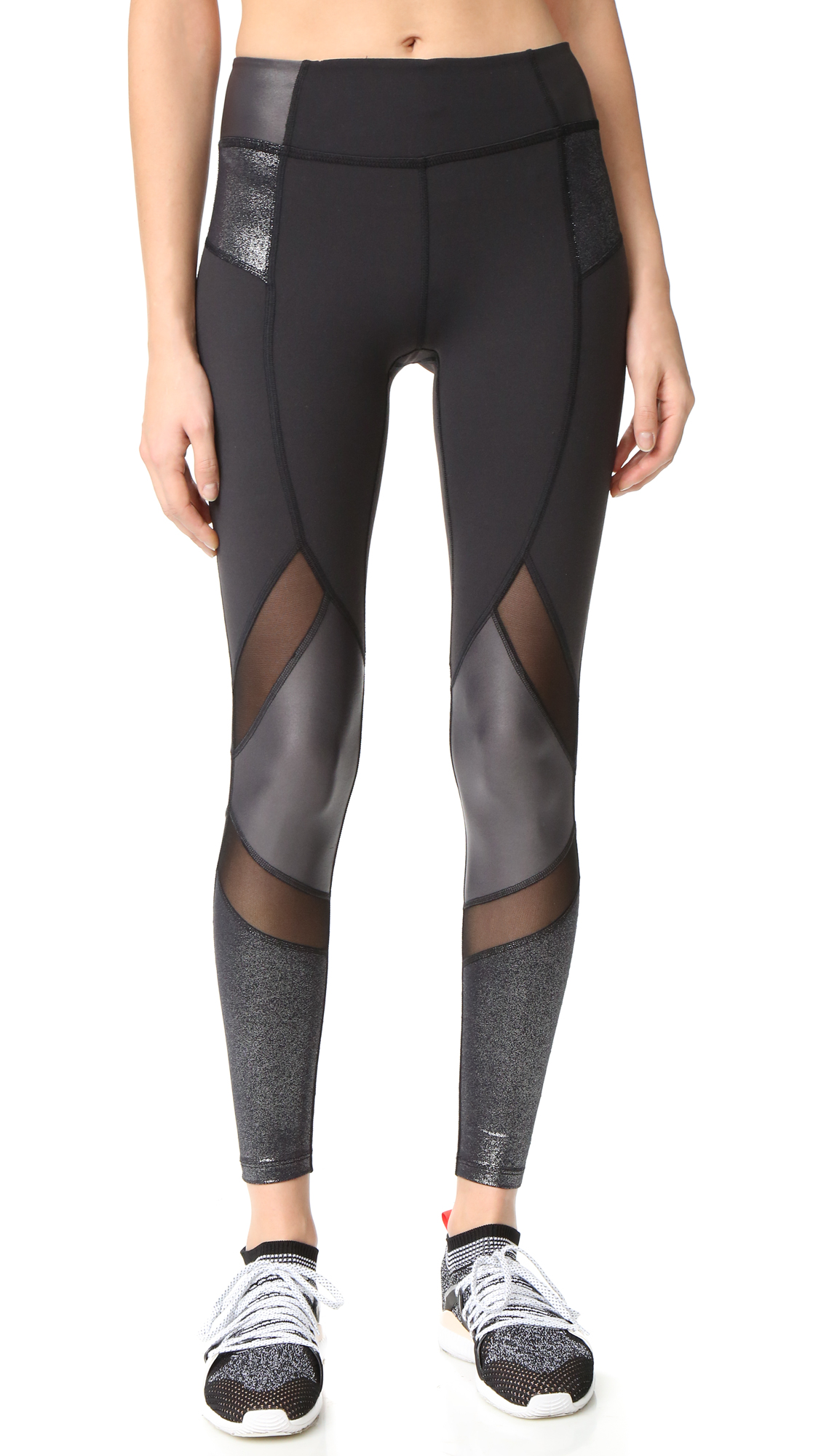 Slinky sections and metallic panels lend an eclectic look to these Beyond Yoga leggings. Fabric: Activewear jersey. 46% nylon/42% polyester/12% elastane. Wash warm. Made in the USA. Imported materials. Measurements Rise: 8.75in / 22cm Inseam: 26.75in / 68cm Measurements