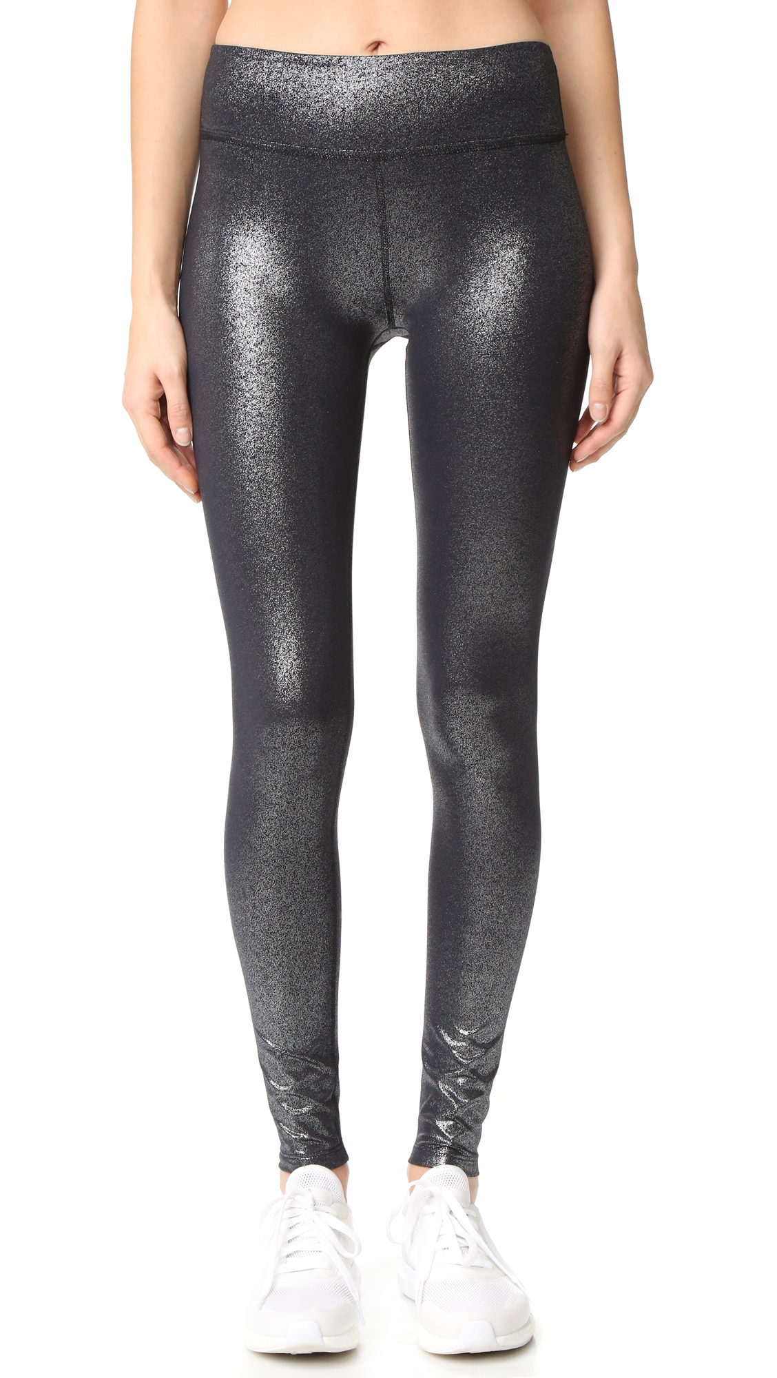 A metallic finish lends a glamorous touch to these Beyond Yoga leggings. Fabric: Activewear jersey. 75% nylon/25% spandex. Wash cold. Made in the USA. Measurements Rise: 8.75in / 22cm Inseam: 27.5in / 70cm Measurements from size S. Available sizes: