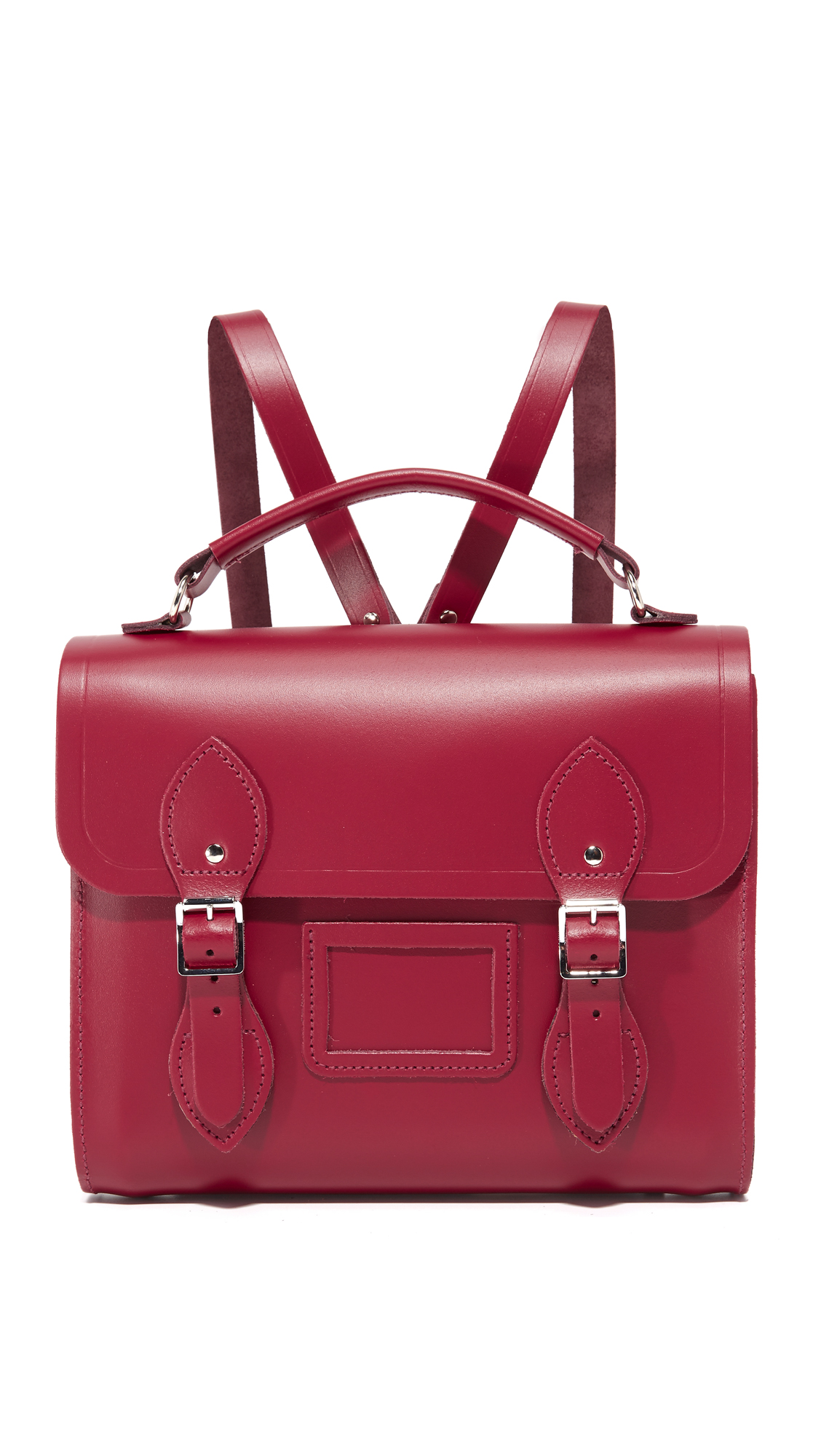 A petite Cambridge Satchel backpack in smooth leather. Magnetic tabs with decorative buckles fasten the top flap. Unlined interior. Top handle and adjustable shoulder straps. Dust bag included. Leather: Cowhide. Weight: 24oz / 0.68kg. Made in United