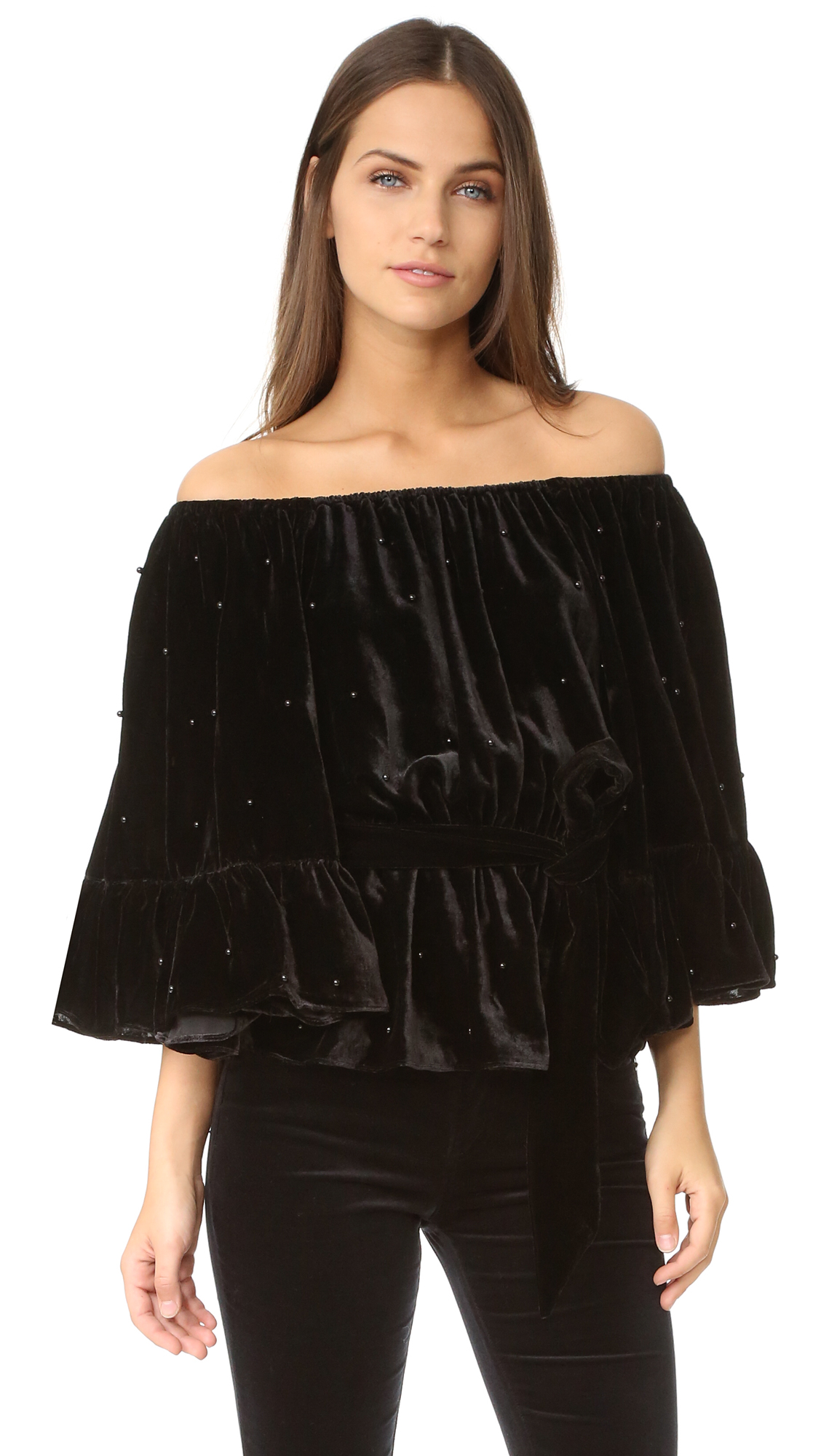 An off shoulder C/Meo Collective top crafted in beaded velvet. Flared 3/4 sleeves and self tie sash at the waist. Covered elastic top hem. Fabric: Velvet. 75% viscose/25% nylon. Dry clean. Imported, China. Measurements Length: 19.75in / 50cm,