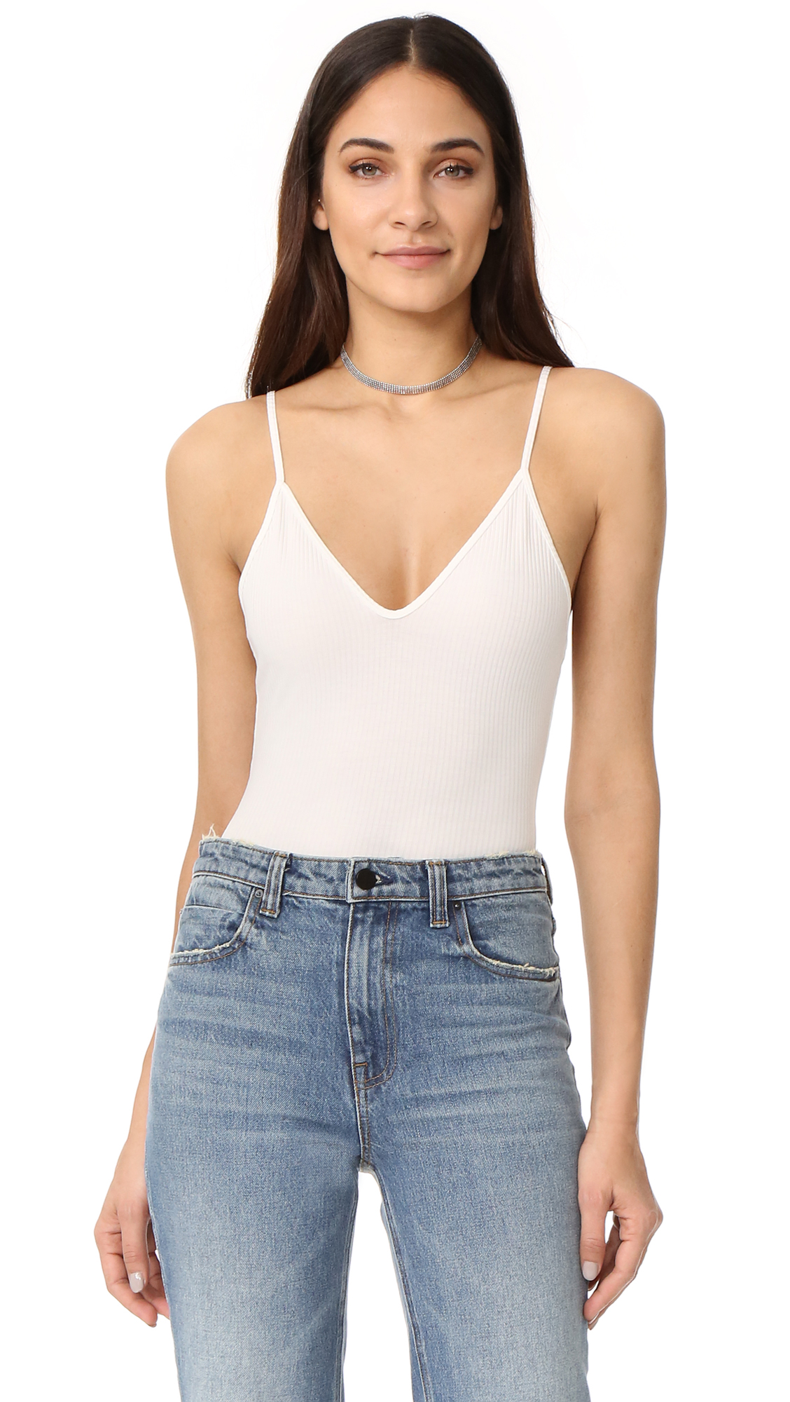 A simple Capulet bodysuit with a V neckline and scoop back. Sleeveless. The bikini cut panty has a snap tab gusset. Fabric: Ribbed jersey. 55% rayon/39% polyester/6% spandex. Dry clean. Imported, China. Size & Fit. Available sizes: L