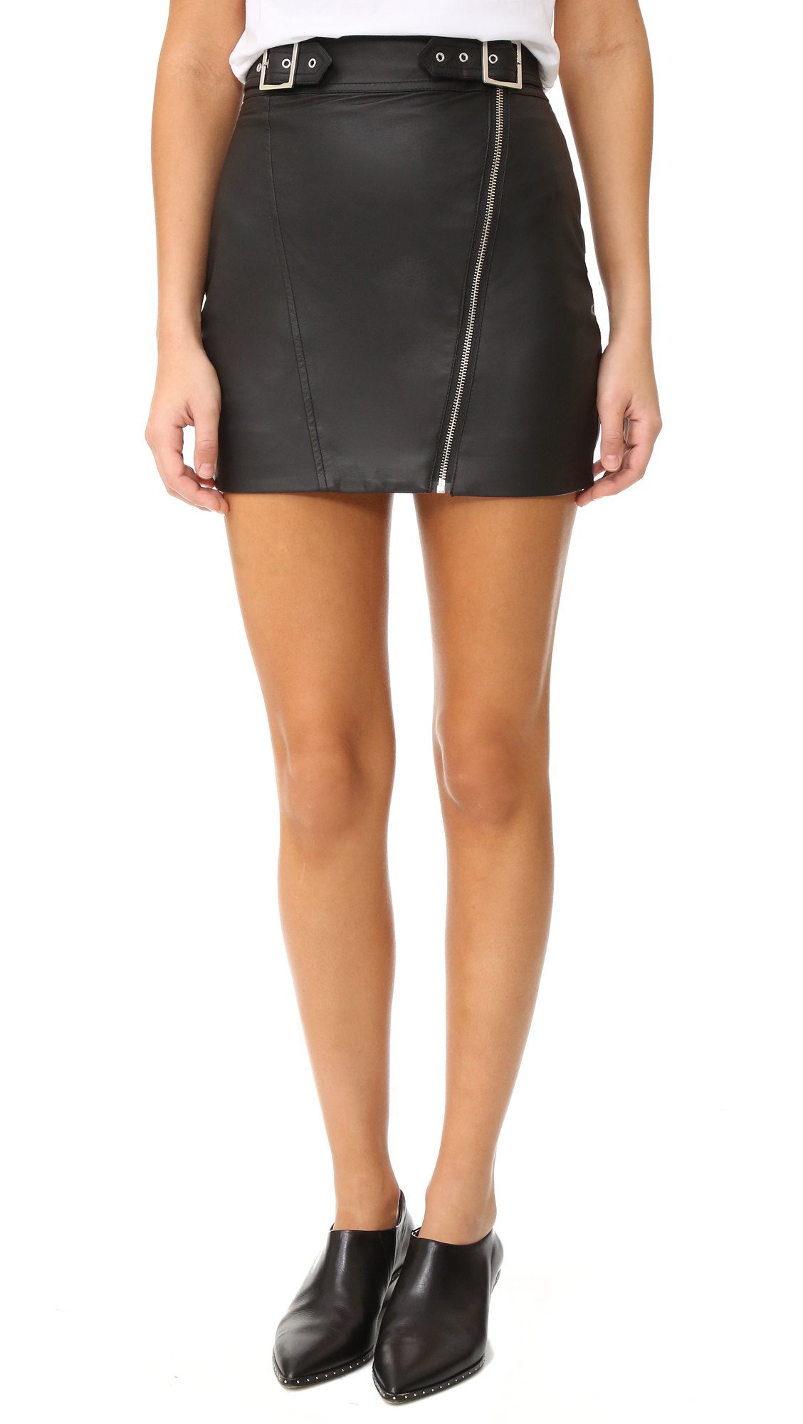 A supple leather Capulet moto skirt feels edgy with a zip closure cutting down the front and buckle straps at the waist. Lined. Fabric: Leather. Shell: 100% cowhide. Lining: 100% polyester. Leather clean. Imported, China. Measurements Length: 15.25in / 39