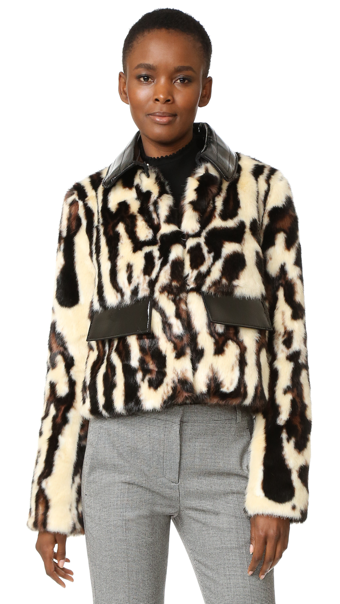 A cropped, leopard print Carven coat in sleek imitation fur and shiny faux patent. Flap front pockets and padded collar. Hook and eye closures fasten the front. Long sleeves. Logo jacquard lining. Fabric: Faux fur. Shell: 100%