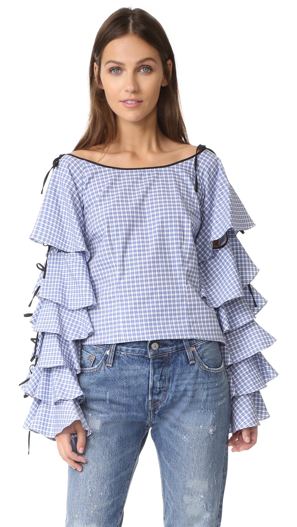 Voluminous ruffles embellish the long sleeves of this shoulder baring Caroline Constas top. Adjustable shoulder ties. Hidden back zip. Fabric: Poplin. 100% cotton. Dry clean. Made in the USA. Measurements Length: 24.5in / 62cm, from shoulder Measurements from