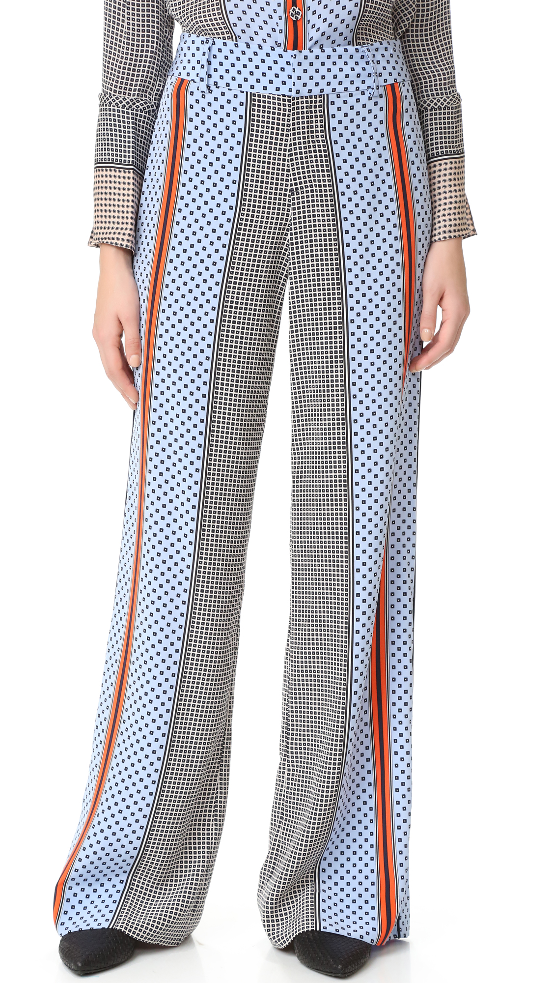 Mixed prints bring vivid contrast to these wide leg Derek Lam 10 Crosby pants. Piping trims the sides and the flap back pockets. Hook and eye closures and zip fly. Fabric: Silk crepe. 100% silk. Dry clean. Imported,