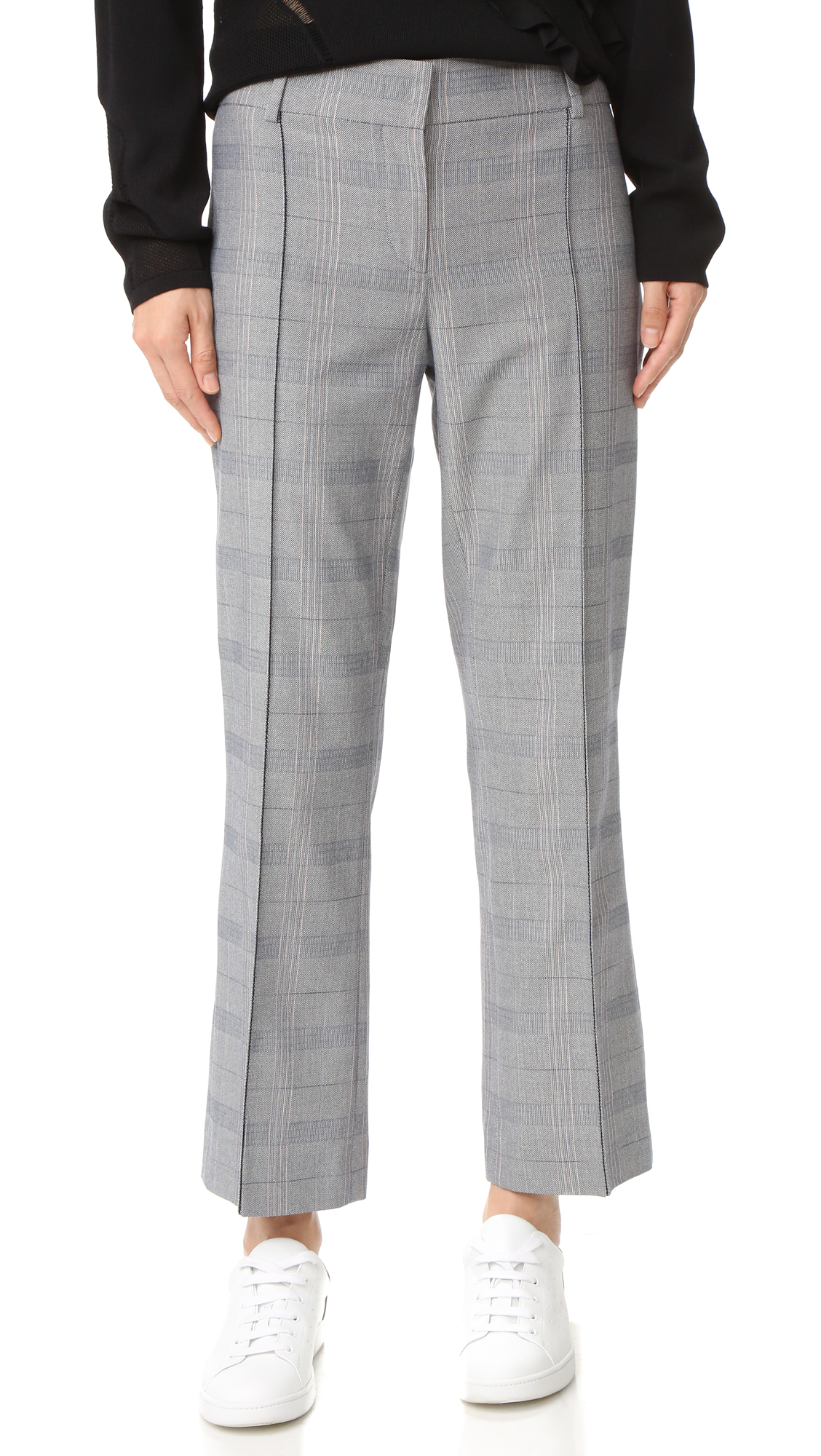 Vertical pintucks lengthen the look of these slim Cedric Charlier pants, rendered in menswear style plaid suiting. Welt back pocket. Hook and eye closure and zip fly. Fabric: Suiting. 100% cotton. Dry clean. Made in Italy. Measurements
