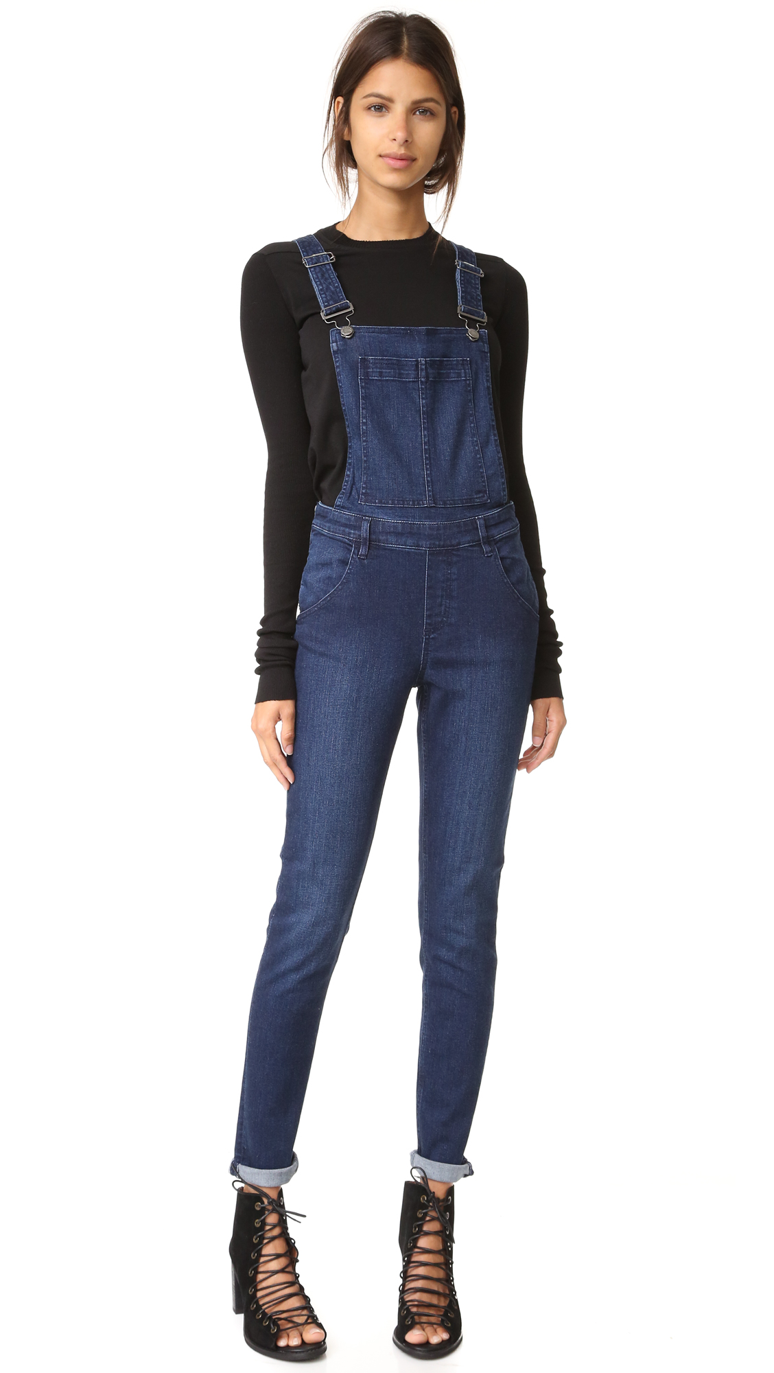 Skinny Cheap Monday overalls in a rich wash. Patch bib pocket. Slant hip pockets and patch back pockets. Exposed side zips. Adjustable shoulder straps. Fabric: Super stretch denim. 75% cotton/13% viscose/11% polyester/1% elastane. Wash cold. Imported, Bangladesh.