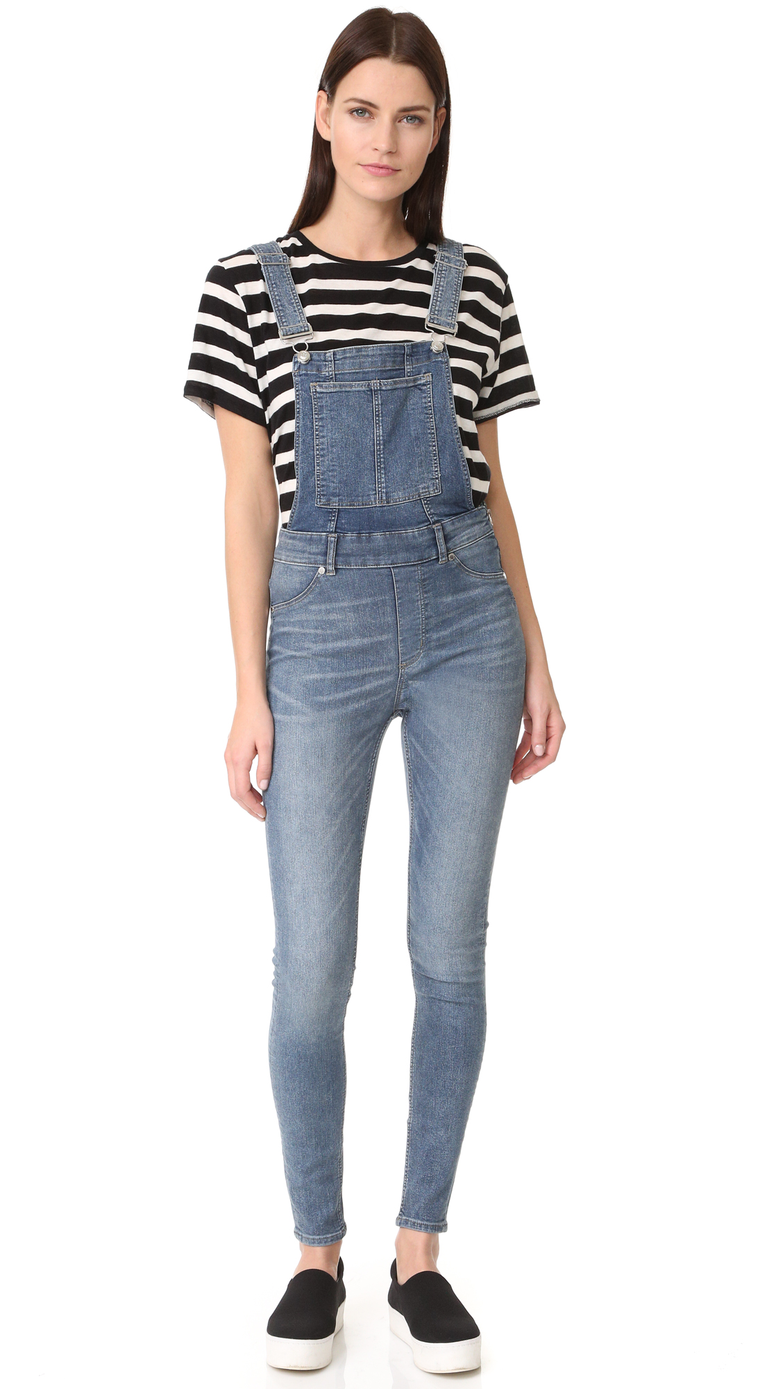 Faded, super stretch Cheap Monday overalls with a slim fit. 2 bib pockets and 2 back pockets. Adjustable straps with buckle closures. Exposed side zip. Fabric: Stretch denim. 79% cotton/19% polyester/2% elastane. Wash cold or dry clean. Imported, Pakistan.
