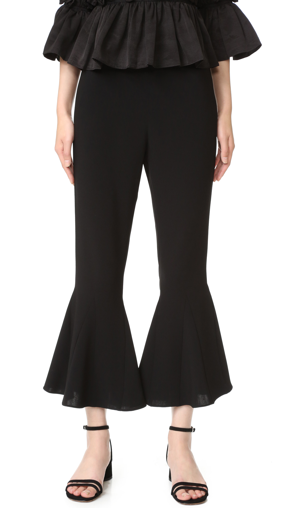 Flared cuffs lend a dramatic touch to these crepe Cinq a Sept cropped pants. Hidden side zip. Fabric: Mid weight crepe. 69% triacetate/31% polyester. Dry clean. Imported, China. Measurements Rise: 11in / 28cm Inseam: 25.25in / 64cm Leg opening: 33