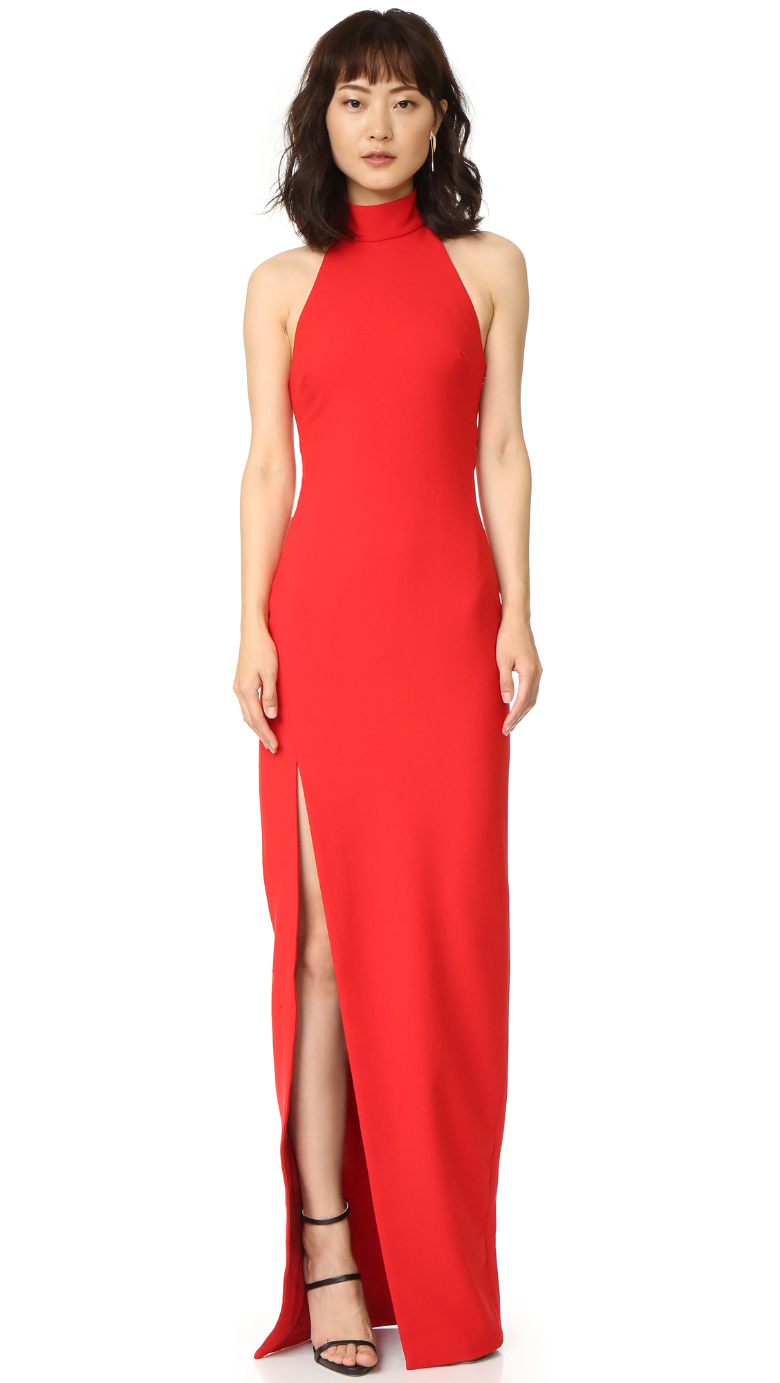 A deep side slit and a back cutout accent this bold Cinq a Sept dress. Button back closures at collar. Hidden side zip. Sleeveless. Lined. Fabric: Suiting. Shell: 54% polyester/39% viscose/7% elastane. Lining: 100% polyester. Dry clean. Imported,