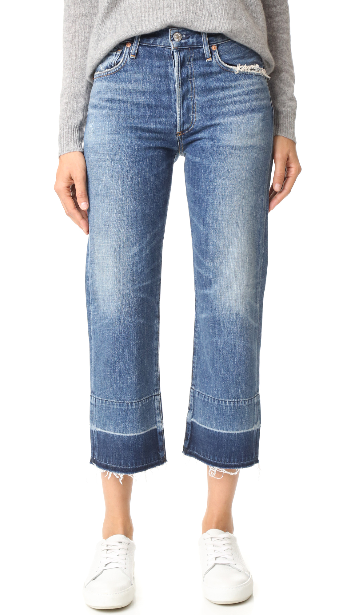 A raw, undone hem complements the relaxed feel of these long rise Citizens of Humanity jeans. Heavy fading and worn spots. 5 pocket styling. Button fly. Fabric: Lightweight denim. 77% cotton/23% rayon. Wash cold. Made in the USA.