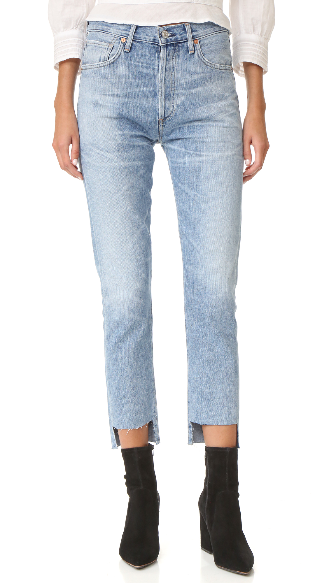 Laid back Citizens of Humanity jeans with whiskered wash and frayed edging. Raw high low hem. 5 pocket styling. Button fly. Fabric: Denim. 77% cotton/23% rayon. Wash cold. Made in the USA. Measurements Rise: 11in / 28cm Inseam: 28.25in / 72