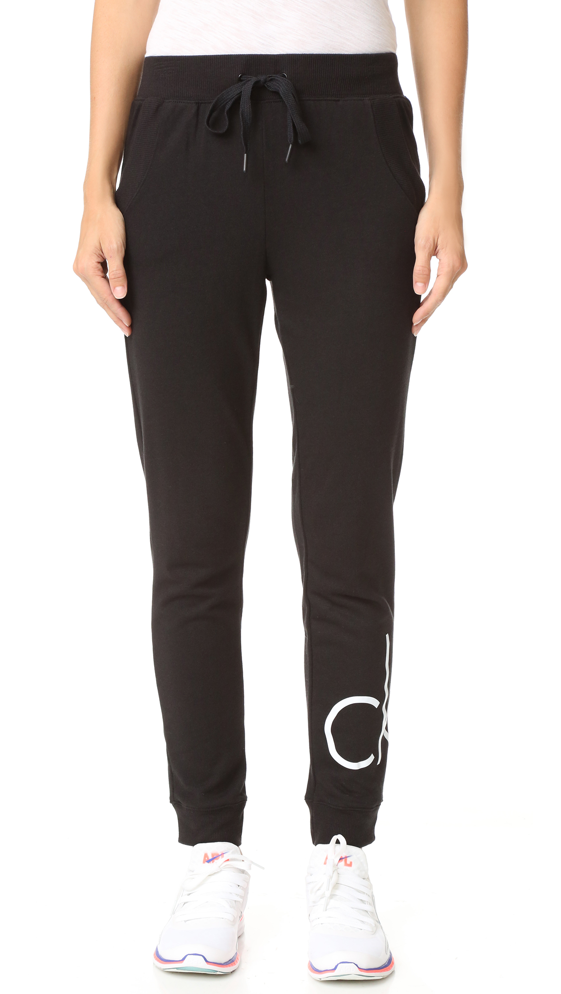 Slouchy Calvin Klein Underwear sweatpants with large logo lettering. Ribbed cuffs. Slant hip pockets. Elastic waistband with drawstring. Fabric: French terry. 40% viscose/37% cotton/23% polyester. Wash cold. Imported, Sri Lanka. Measurements Rise: 10.75in / 27cm Inseam: 26in / 66cm