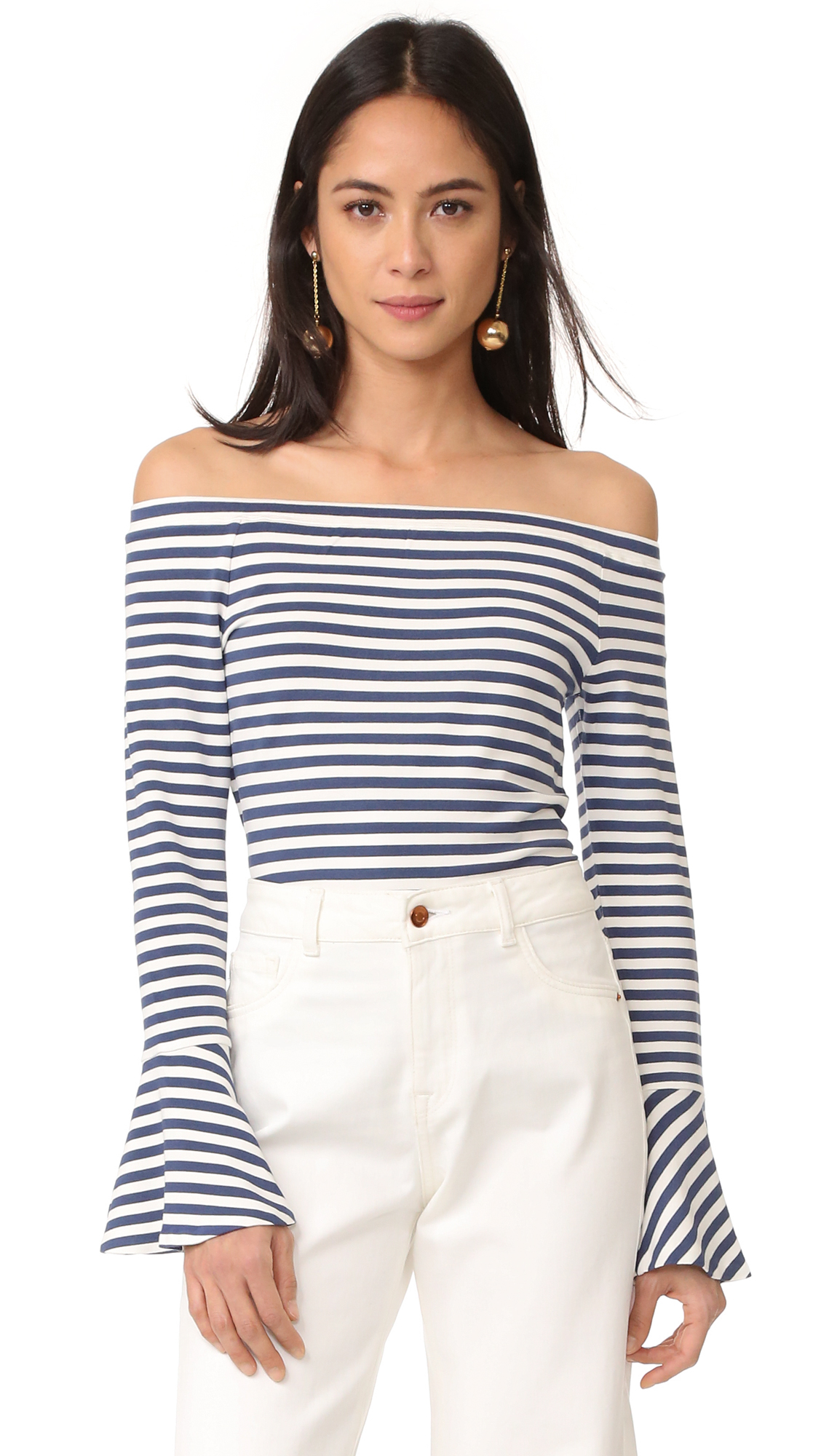 A striped Club Monaco top with a flattering off the shoulder neckline. Long sleeves with flared cuffs. Fabric: French terry. 95% viscose/5% elastane. Hand wash. Imported, China. Measurements Length: 20.5in / 52cm, from center back Measurements from size