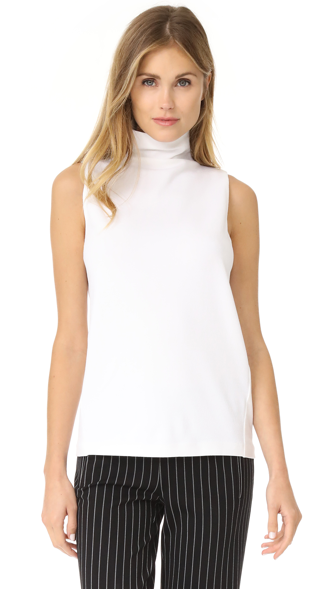 A sleeveless Club Monaco turtleneck top and slanted side seams. Fabric: Mid-weight crepe. 70% viscose/27% nylon/3% elastane. Dry clean. Imported, China. Measurements Length: 24in / 61cm, from shoulder Measurements from size S