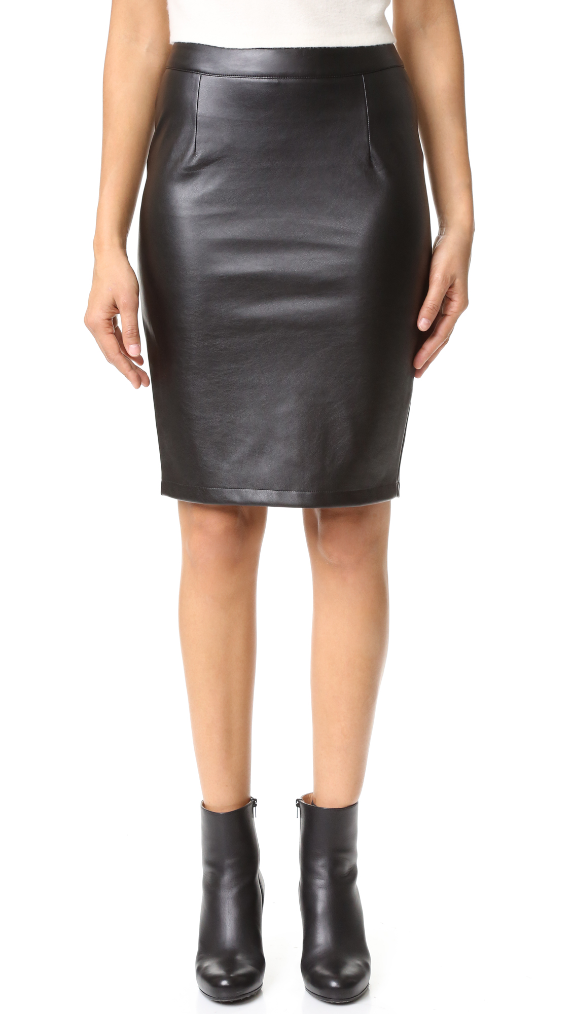 Soft, lightweight faux leather lends subtle edge to a classic cupcakes and cashmere pencil skirt. Exposed zip closure and vent at back. Brushed backing. Fabric: Faux leather. Shell: 100% polyurethane. Backing: 100% polyester. Spot clean. Imported, China. Measurements