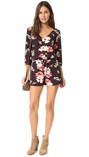 cupcakes and cashmere Juliette Printed Long Sleeve Romper