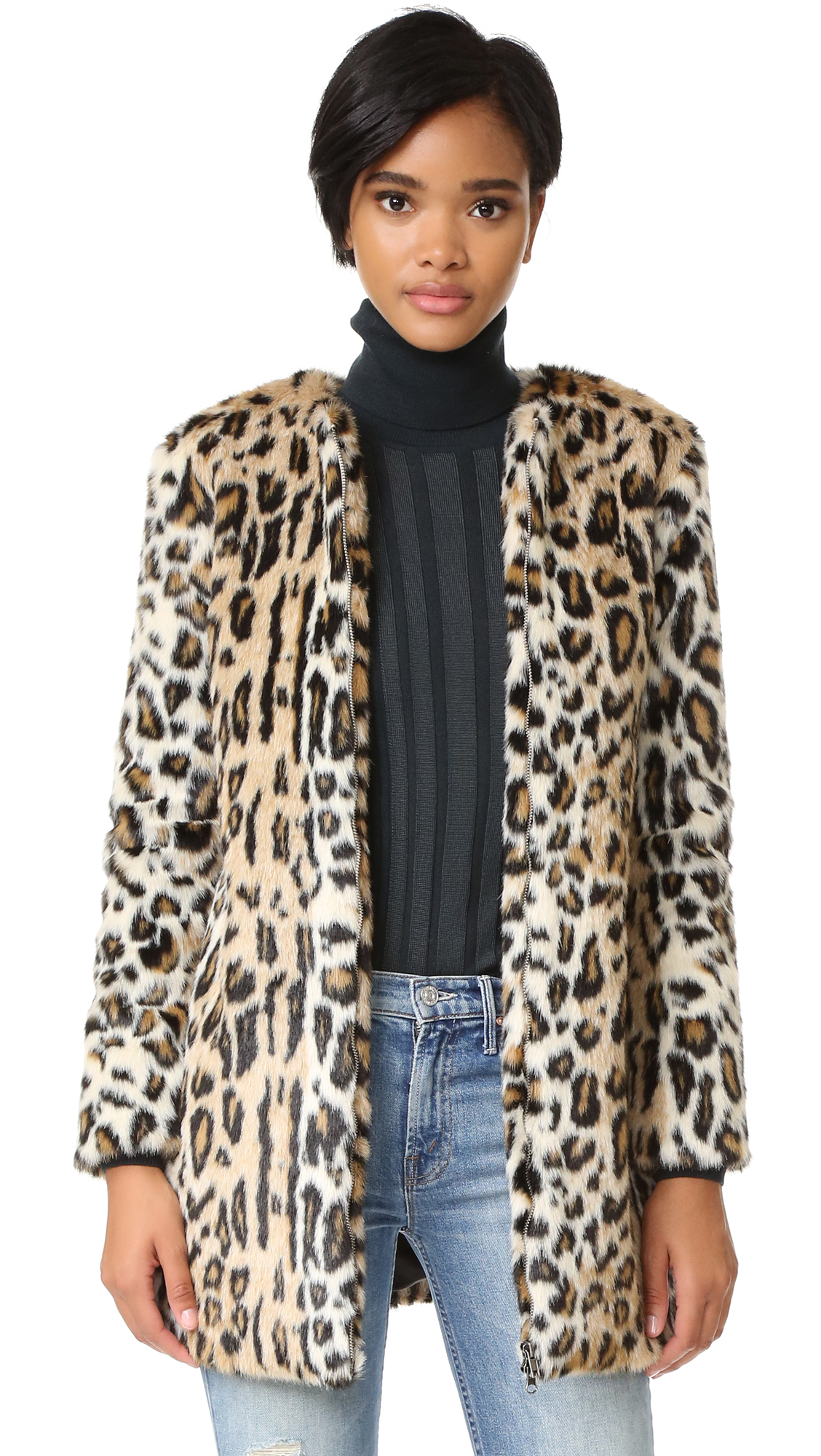 This cupcakes and cashmere coat makes a daring impression in leopard print faux fur. Zip placket and on seam pockets. Long sleeves. Lined. Fabric: Faux fur. Shell: 74% modacrylic/13% acrylic/13% polyester. Lining: 100% polyester. Hand wash. Imported, China.