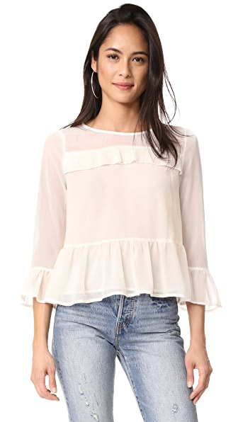 cupcakes and cashmere Katlyn Peplum Blouse In Ivory